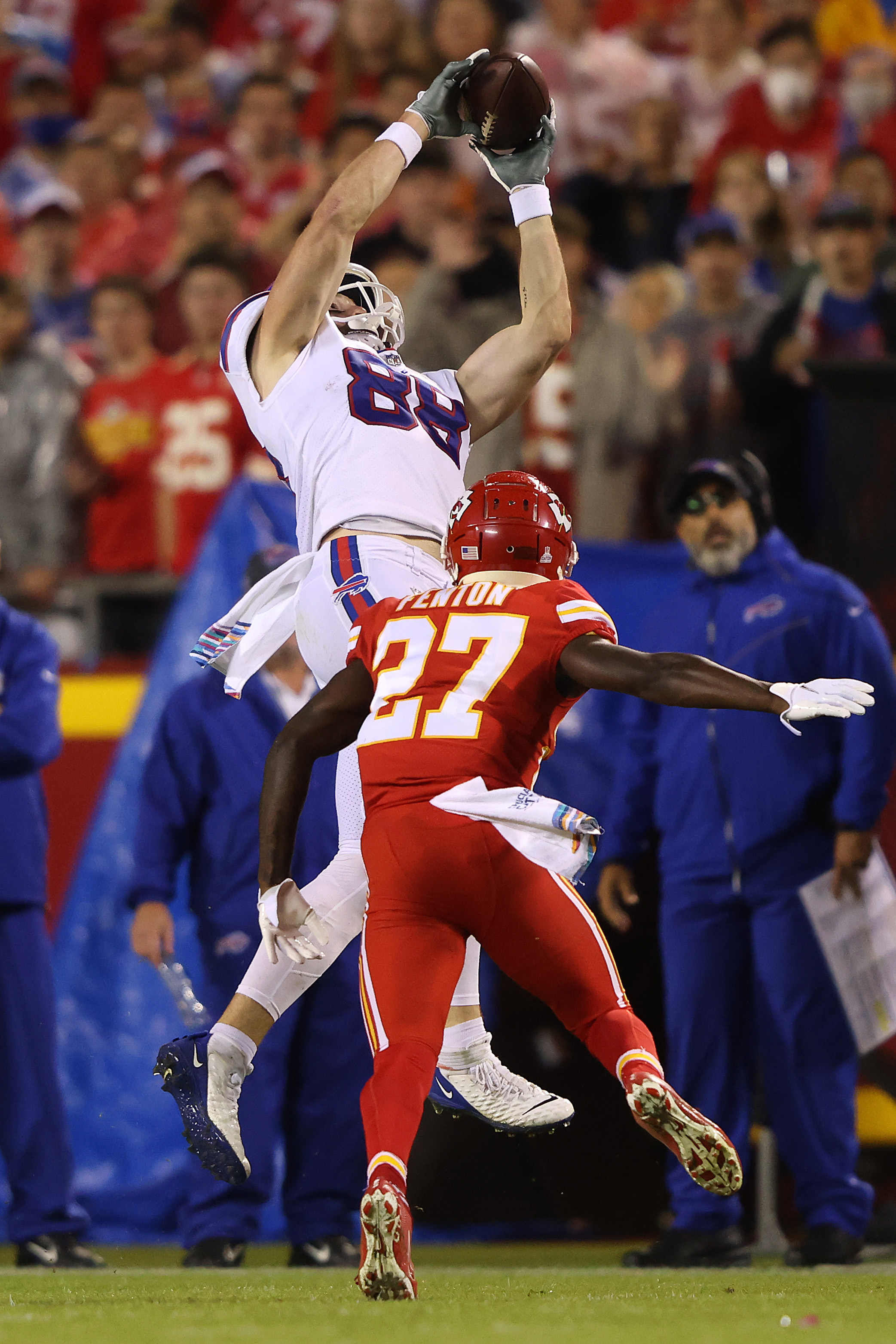 Dawson Knox #88 of the Buffalo Bills makes a reception past the defense of Rashad Fenton #27 of the Kansas City Chiefs during the second half of a game at Arrowhead Stadium on October 10, 2021 in Kansas City, Missouri.