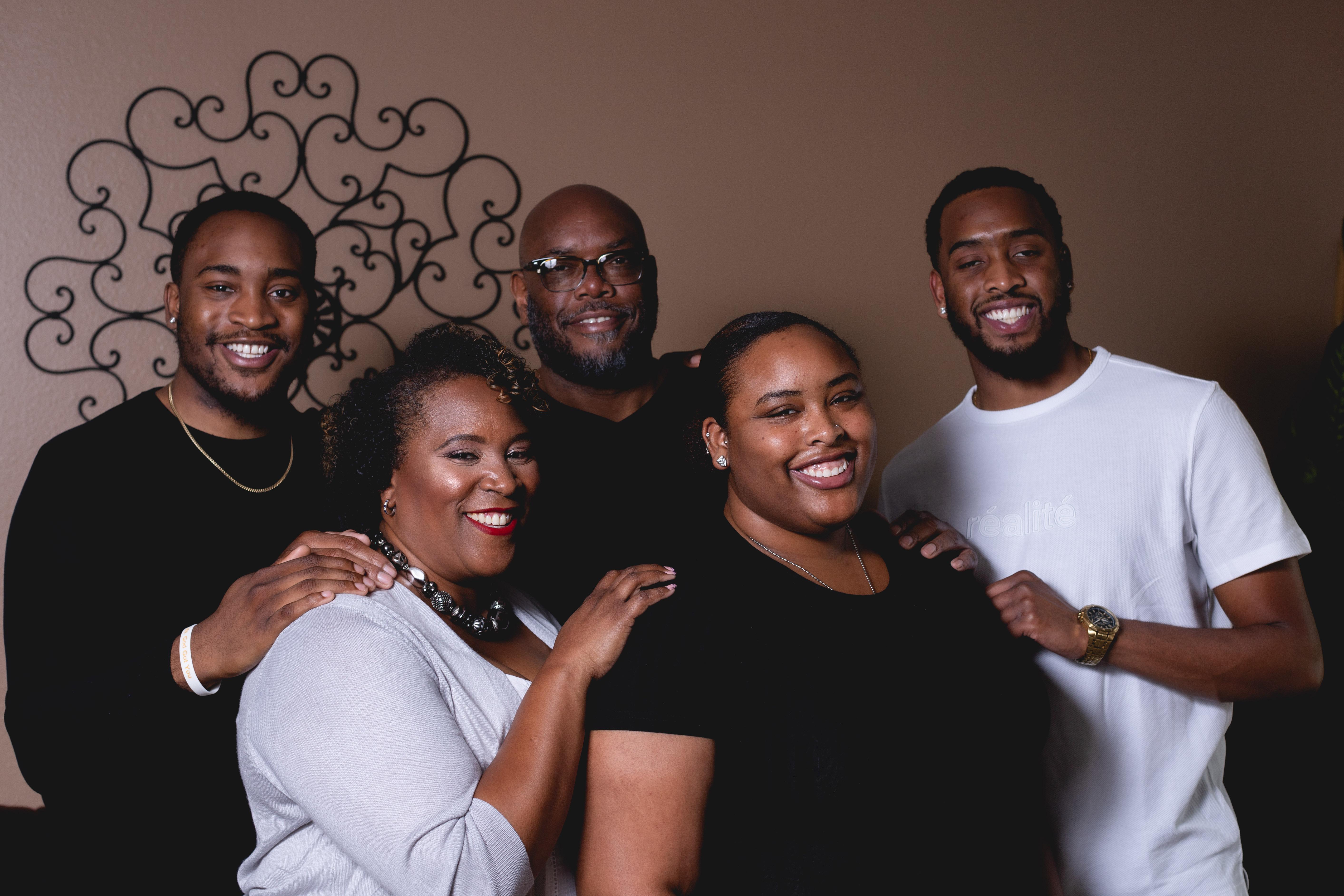 A portrait of Denver School Board candidate Michelle Quattlebaum and four family members.