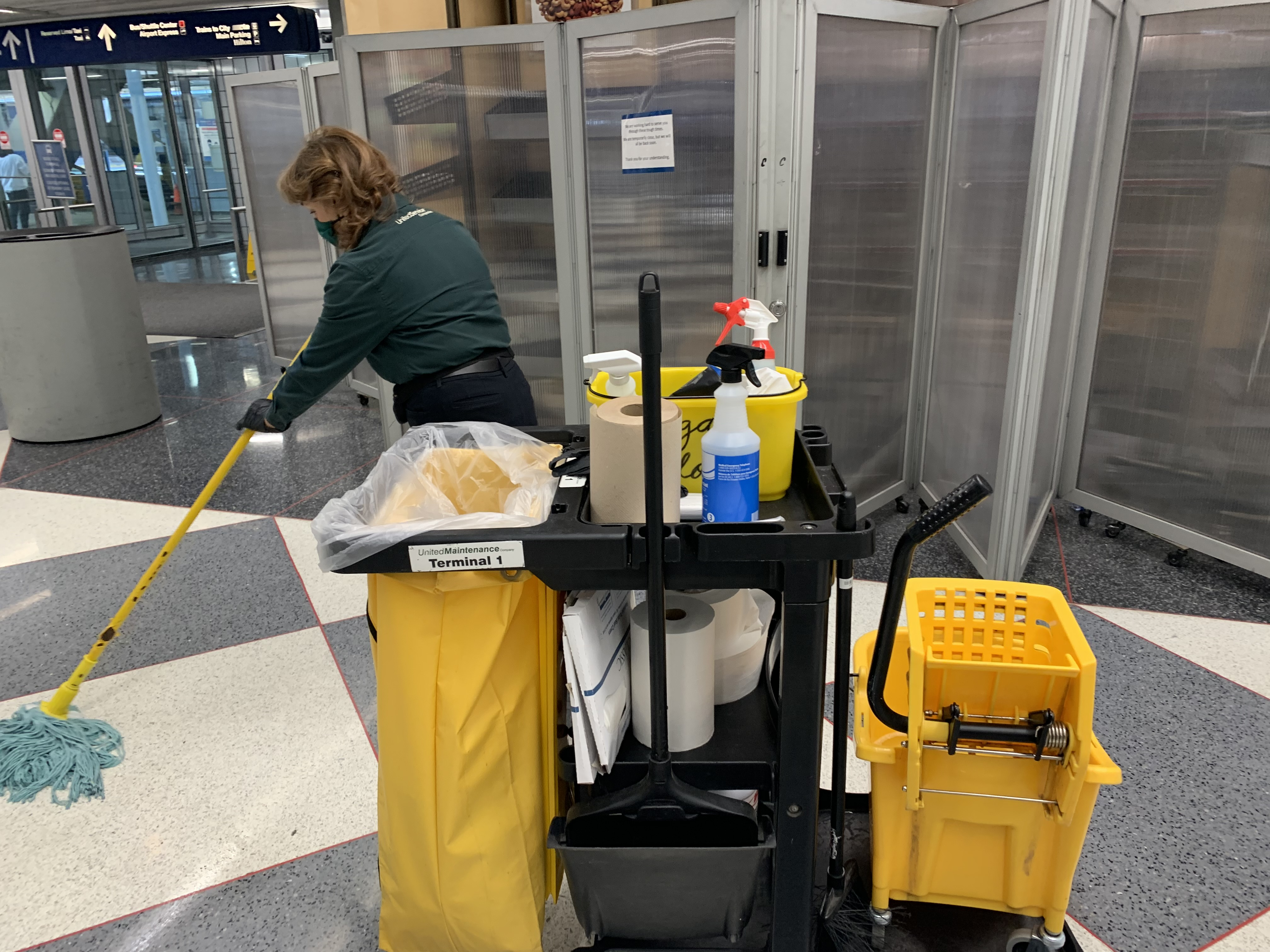 A United Maintenance Company Inc. employee at work Tuesday at O'Hare Airport. The company is suing City Hall in an effort to hold onto a janitorial services deal that's paid it almost $200 million over nearly a decade.
