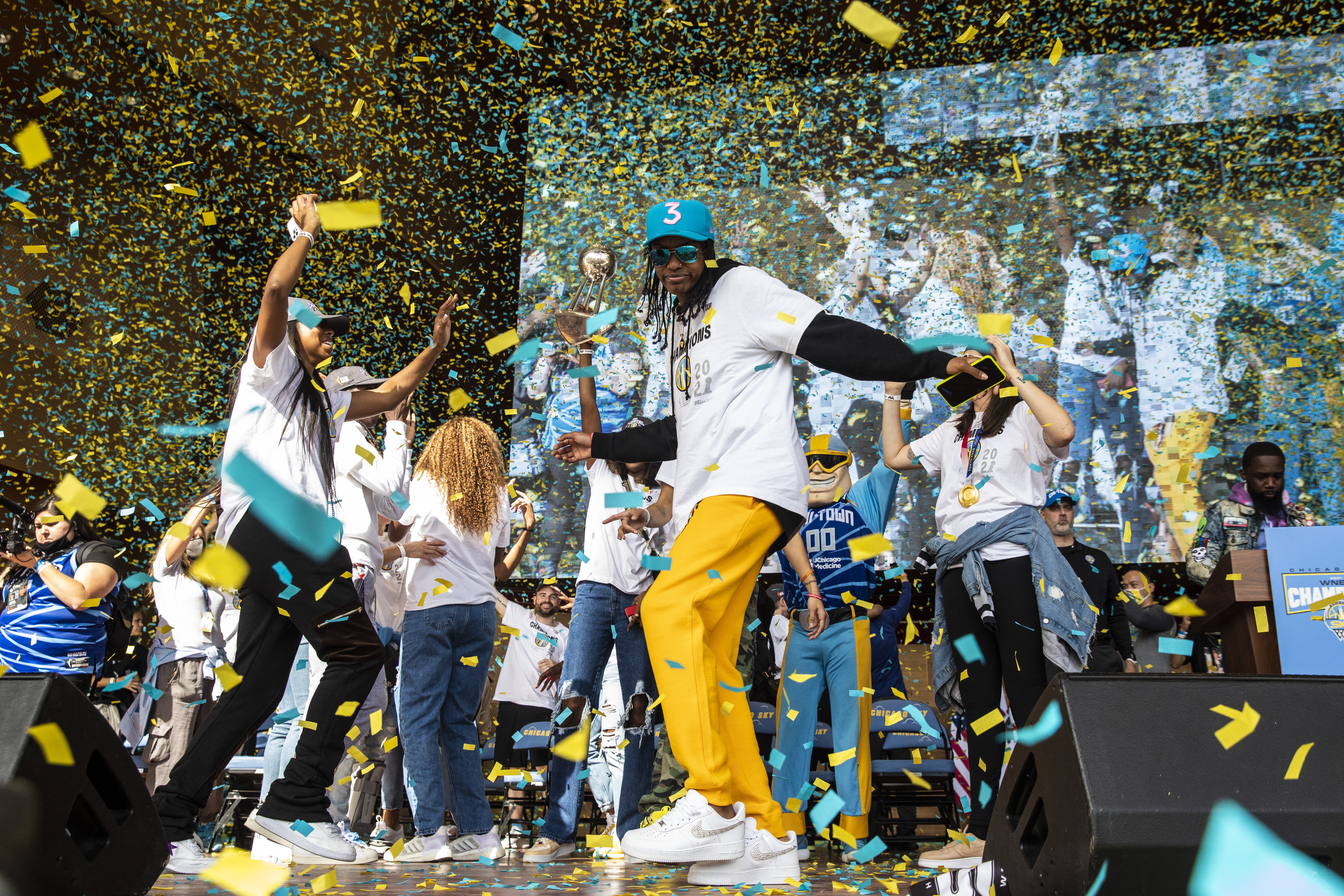 The Chicago Sky players celebrate their WNBA Championship title at Pritzker Pavilion.