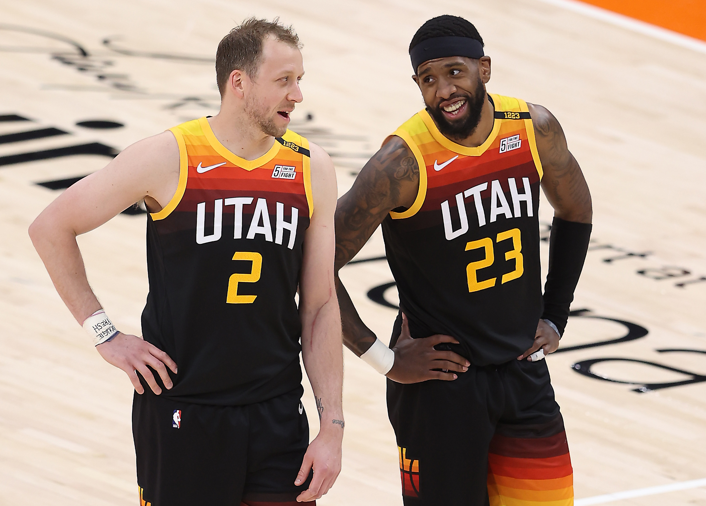 Utah Jazz guard Joe Ingles, left, and Royce O'Neale talk during free throw as the Jazz and Cleveland play in Salt Lake City.