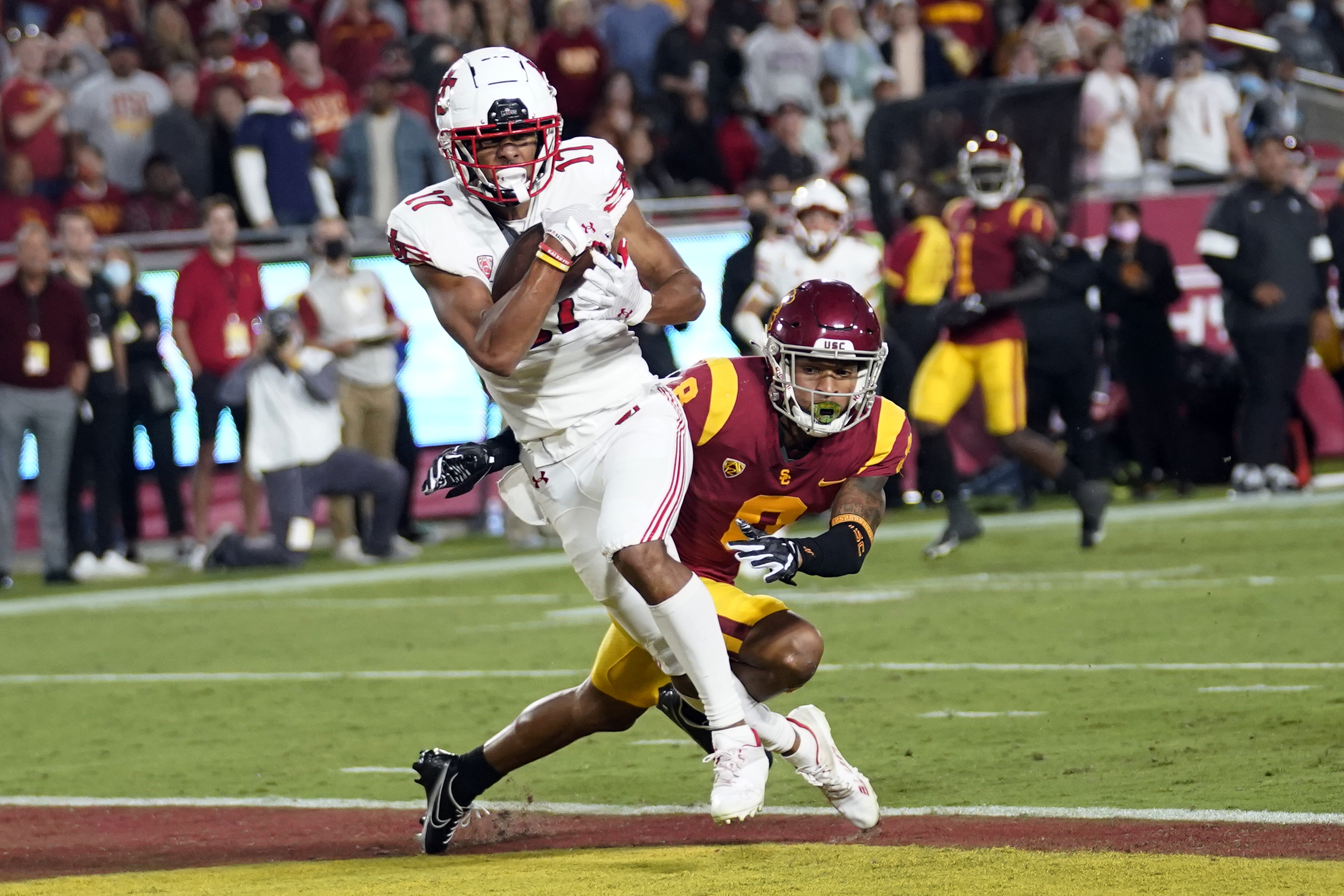 Utah wide receiver Devaughn Vele, left, makes a touchdown catch past USC cornerback Chris Steele during game Oct. 9, 2021.