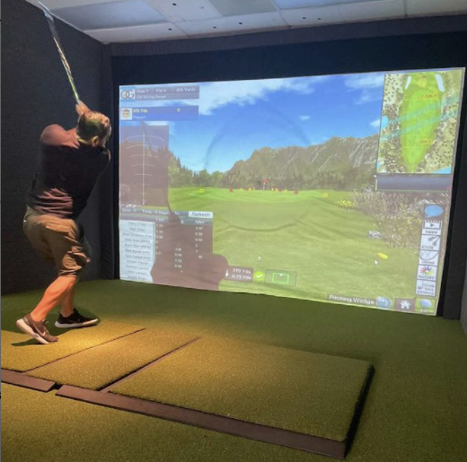 A golfer takes a swing at Birdies N Brews in Long Beach, California