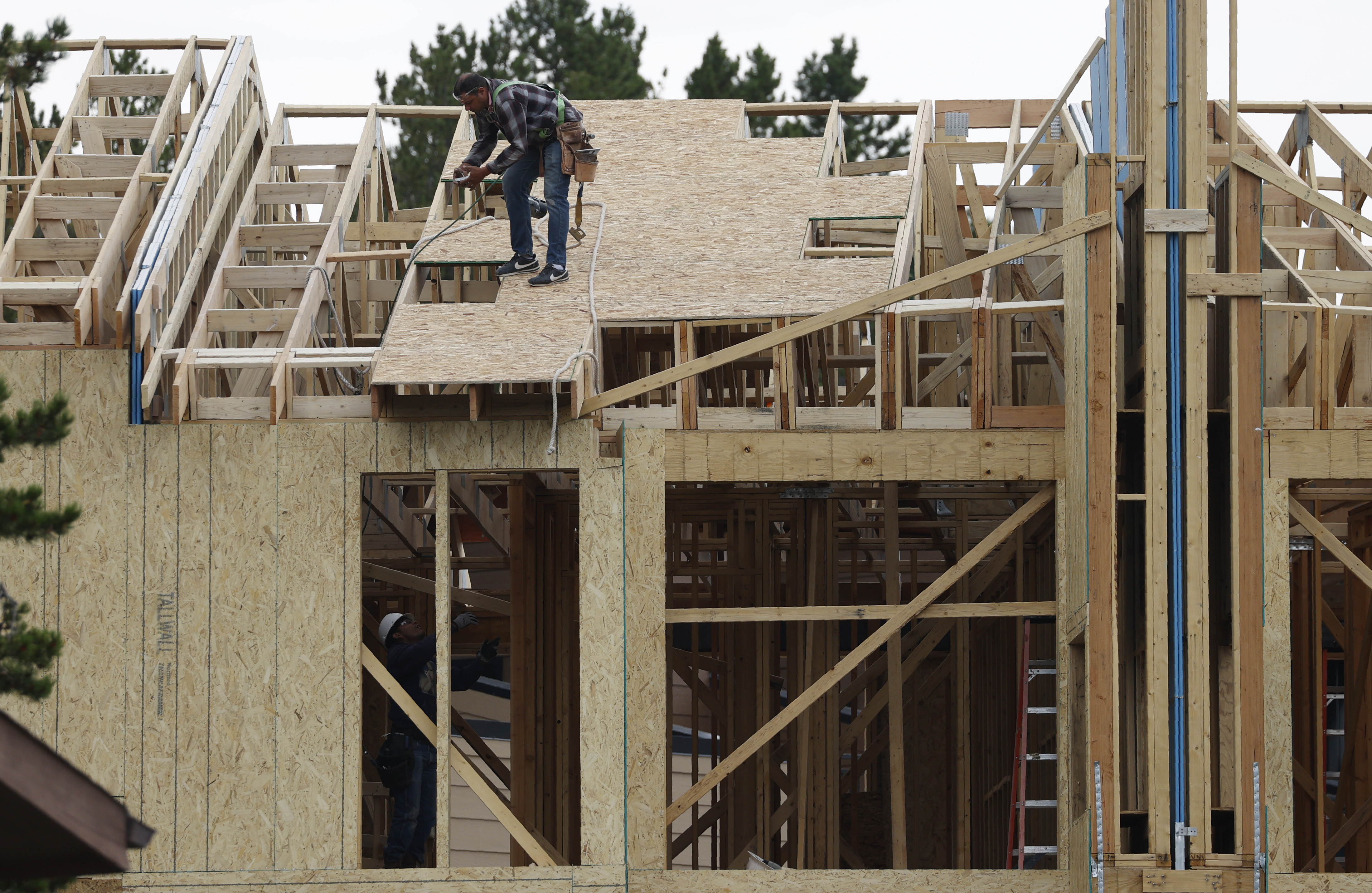 Workers toil on a multifamily dwelling in Winter Park, Colo., on Tuesday, Aug. 4, 2020.