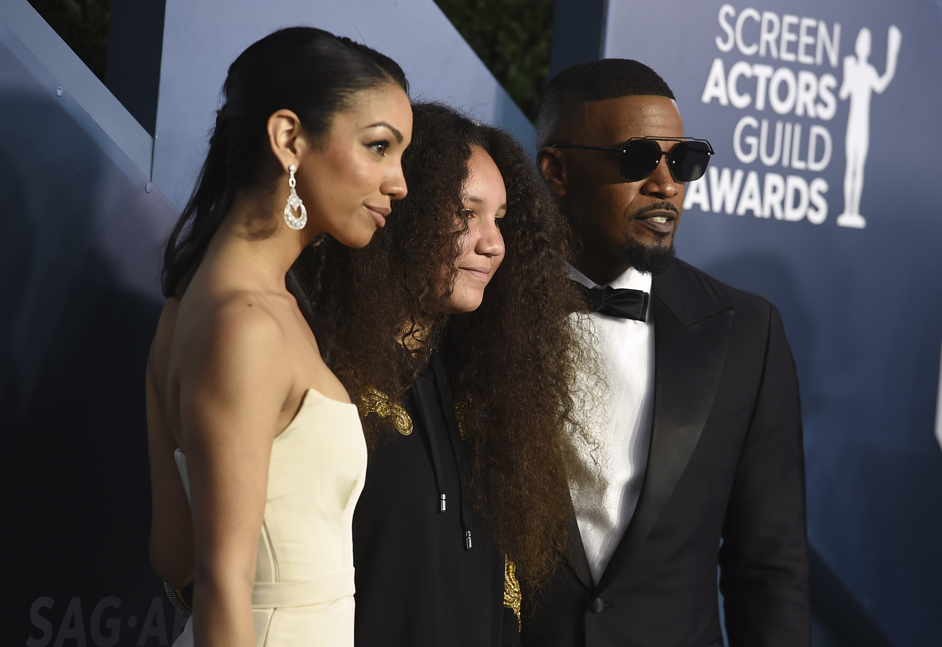 Actor-singer Jamie Foxx poses with his daughters Corinne Foxx (left) and Anelise Bishop at the 26th annual Screen Actors Guild Awards in Los Angeles on Jan. 19, 2020.