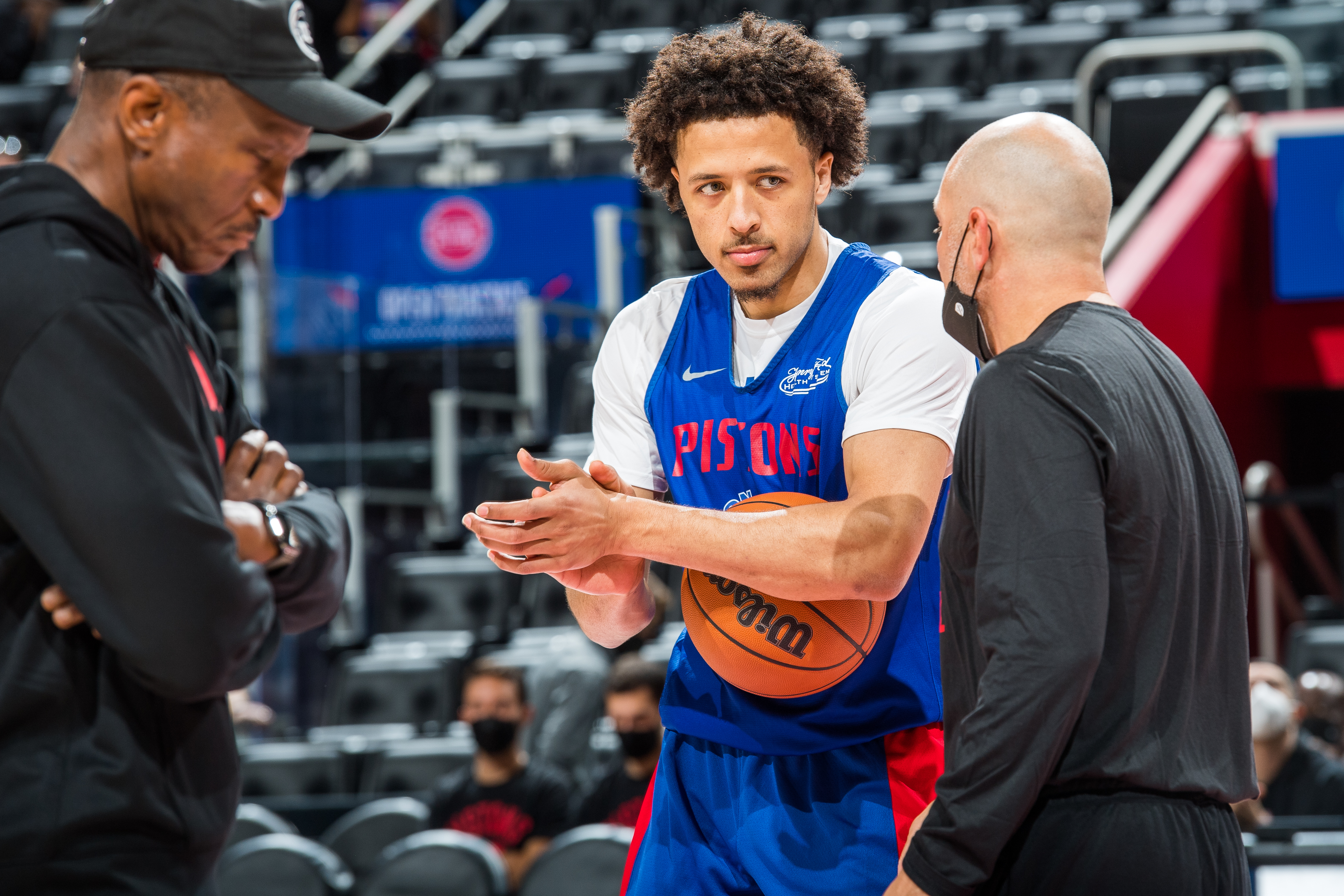 Cade Cunningham #2 of the Detroit Pistons talks to his coaches during open practice at the Little Caesars Arena on October 9, 2021 in Detroit, Michigan.