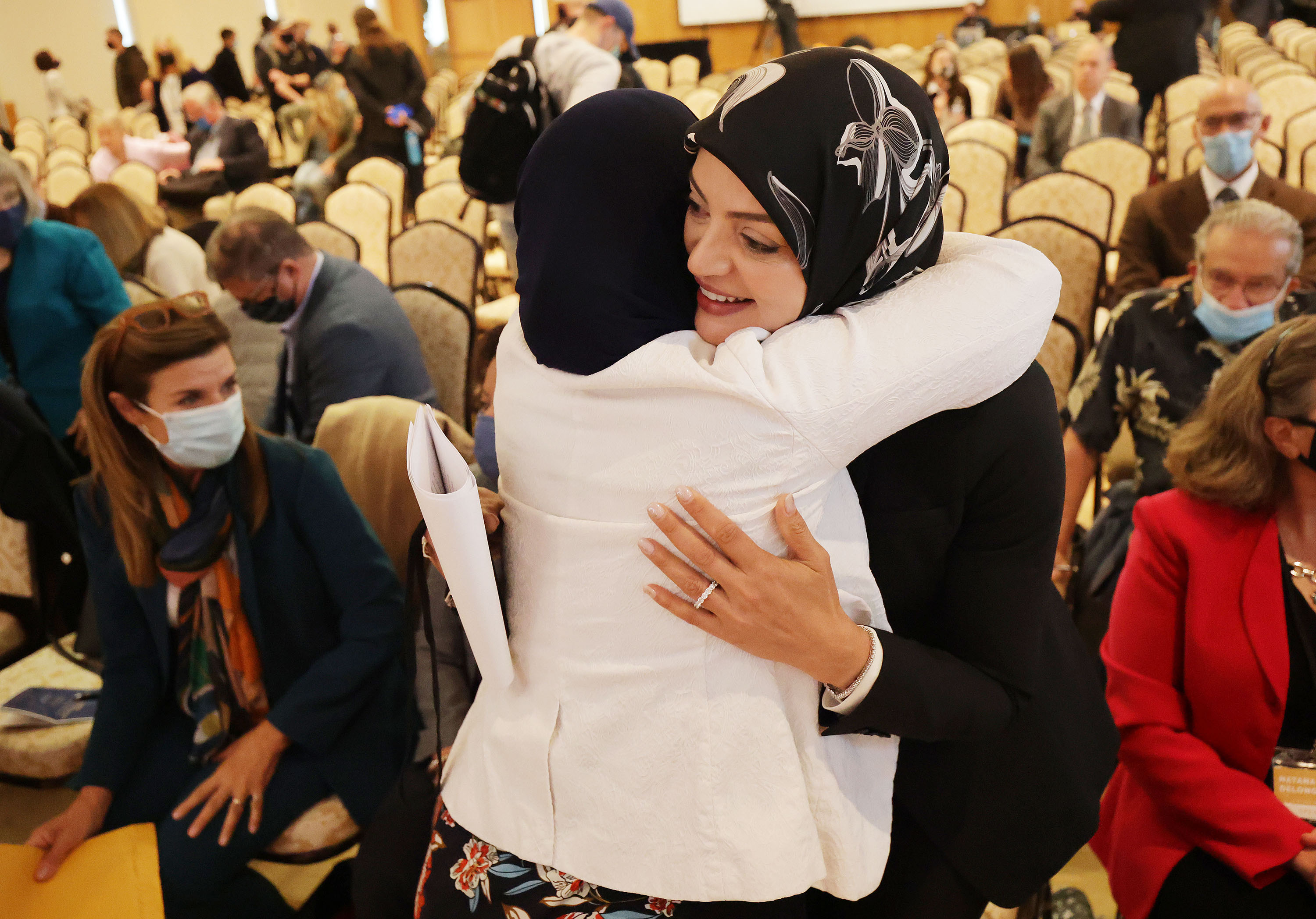 Dalia Fahmy gets a hug after speaking at the Islamic World Today conference at Brigham Young University in Provo on Tuesday, Oct. 19, 2021.