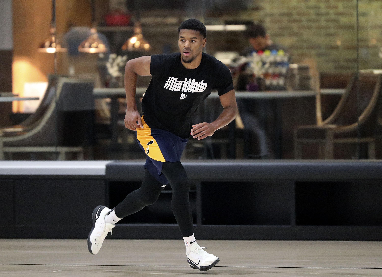 Jared Butler runs during practice