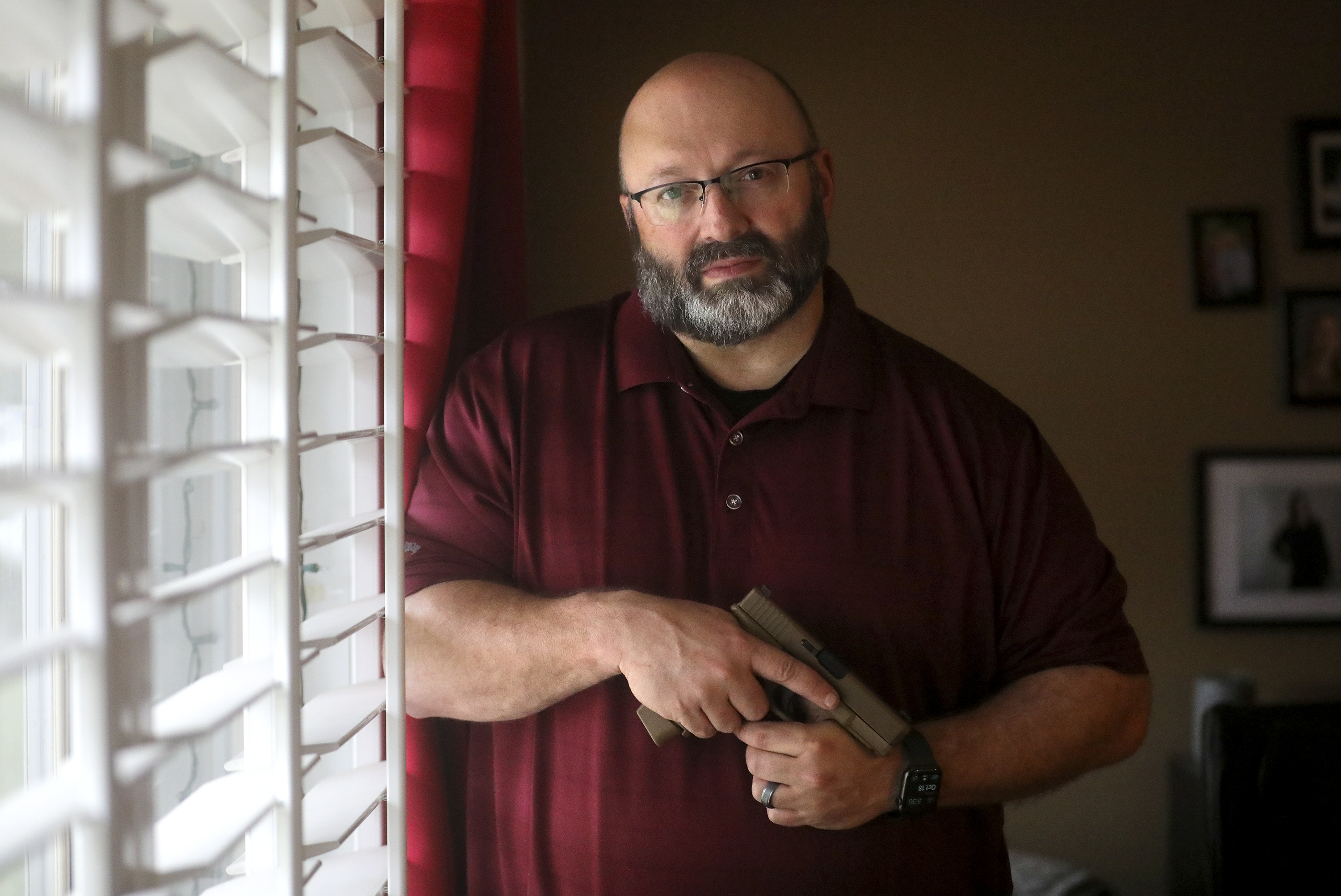 Aaron Turner, a concealed carry instructor, poses for a portrait with his Glock 19X pistol at his home in Murray on Monday, Oct. 18, 2021.