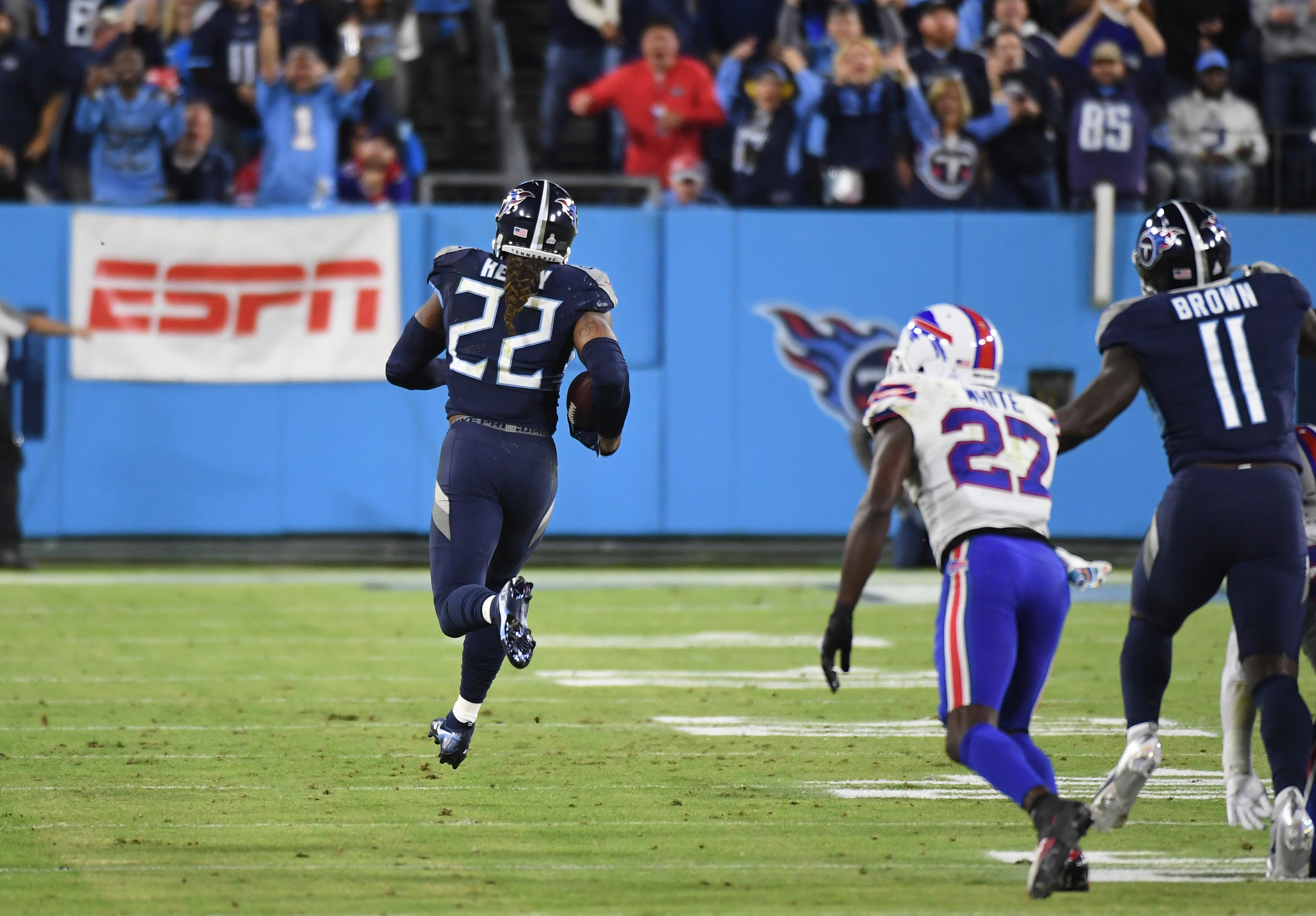 Tennessee Titans running back Derrick Henry (22) runs for a touchdown during the first half against the Buffalo Bills at Nissan Stadium.