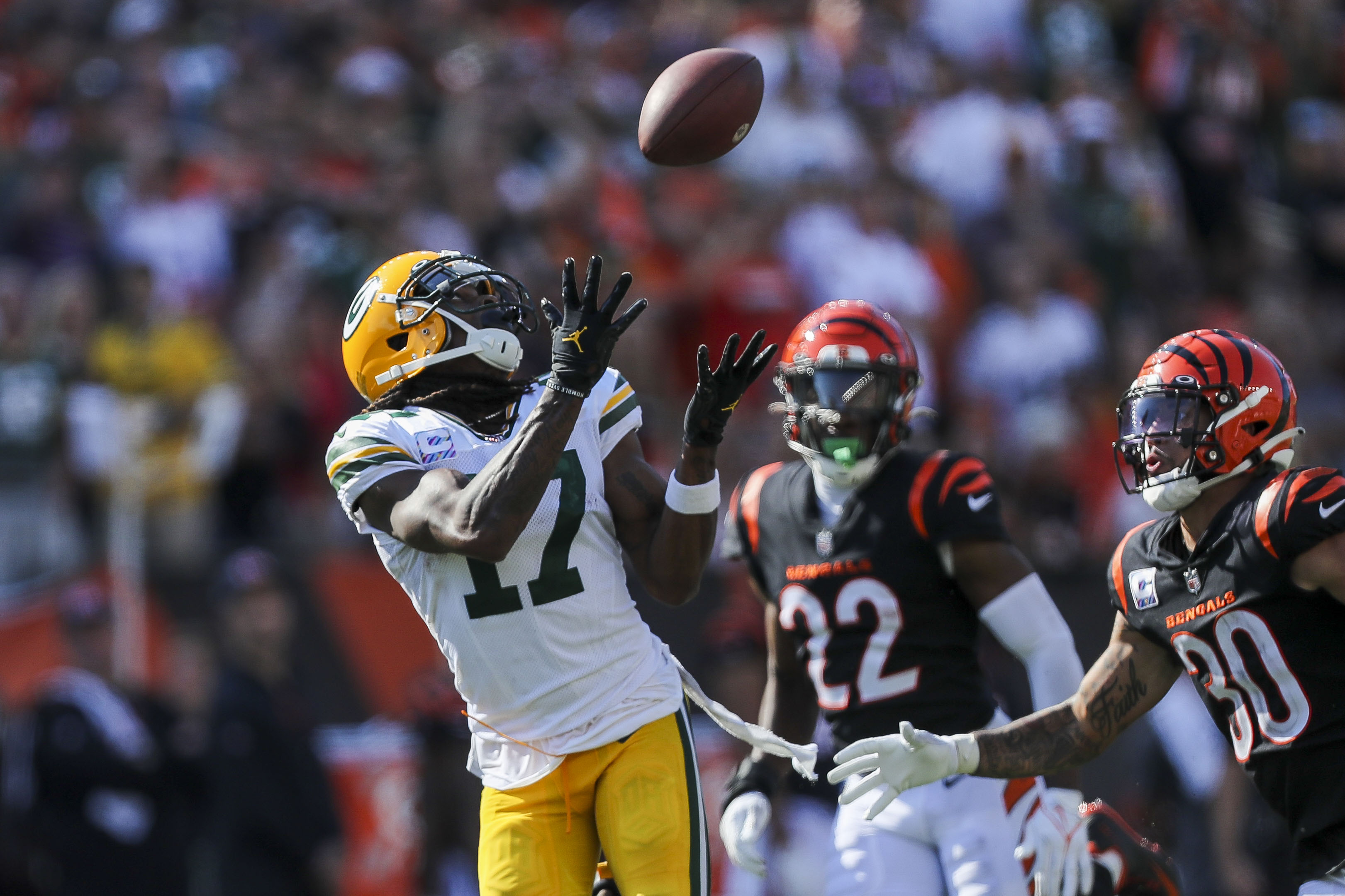 Green Bay Packers wide receiver Davante Adams catches a pass against Cincinnati Bengals safety Jessie Bates III in the second half at Paul Brown Stadium.