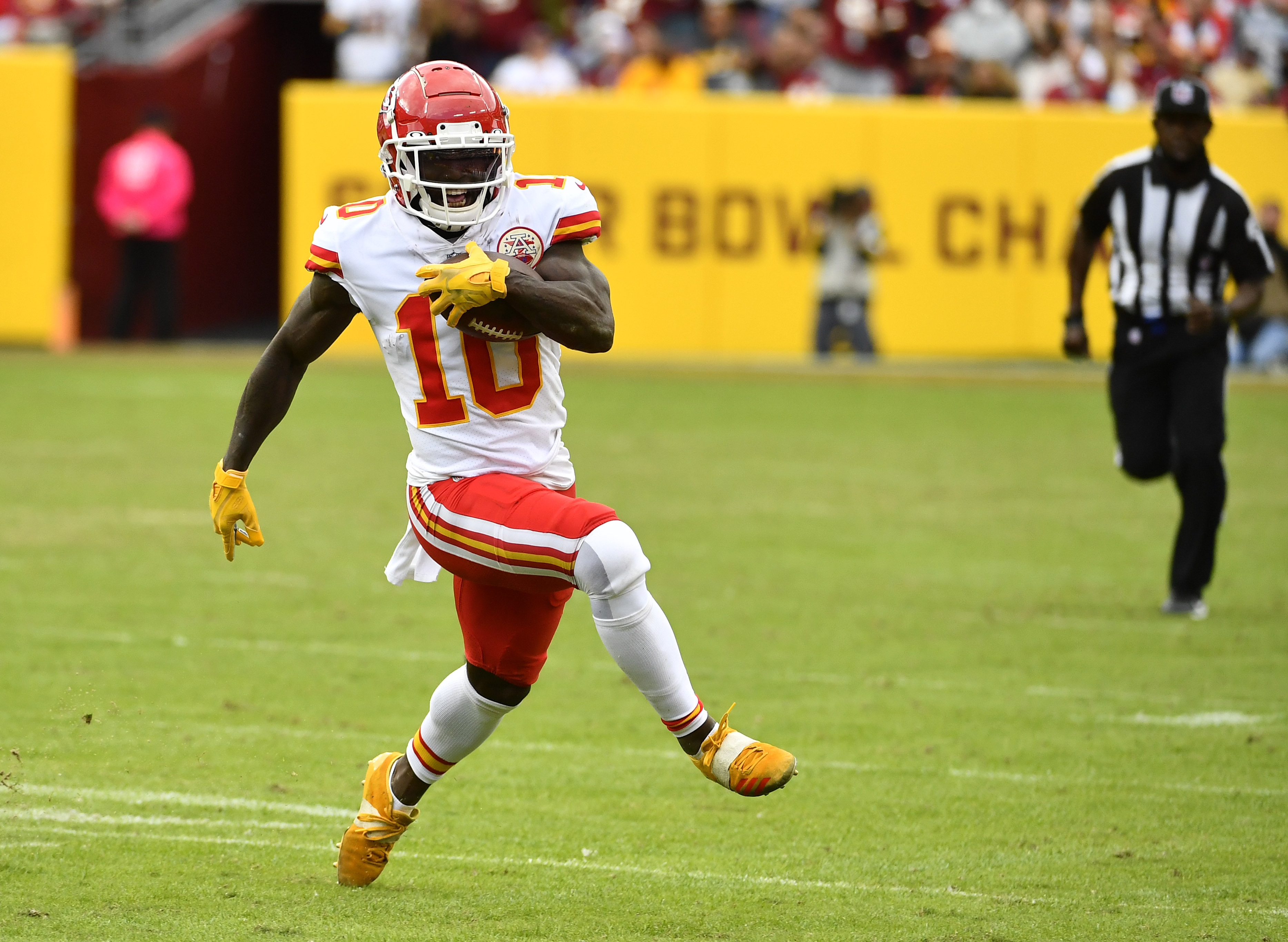 Kansas City Chiefs wide receiver Tyreek Hill (10) runs after a catch against the Washington Football Team during the second half at FedExField.