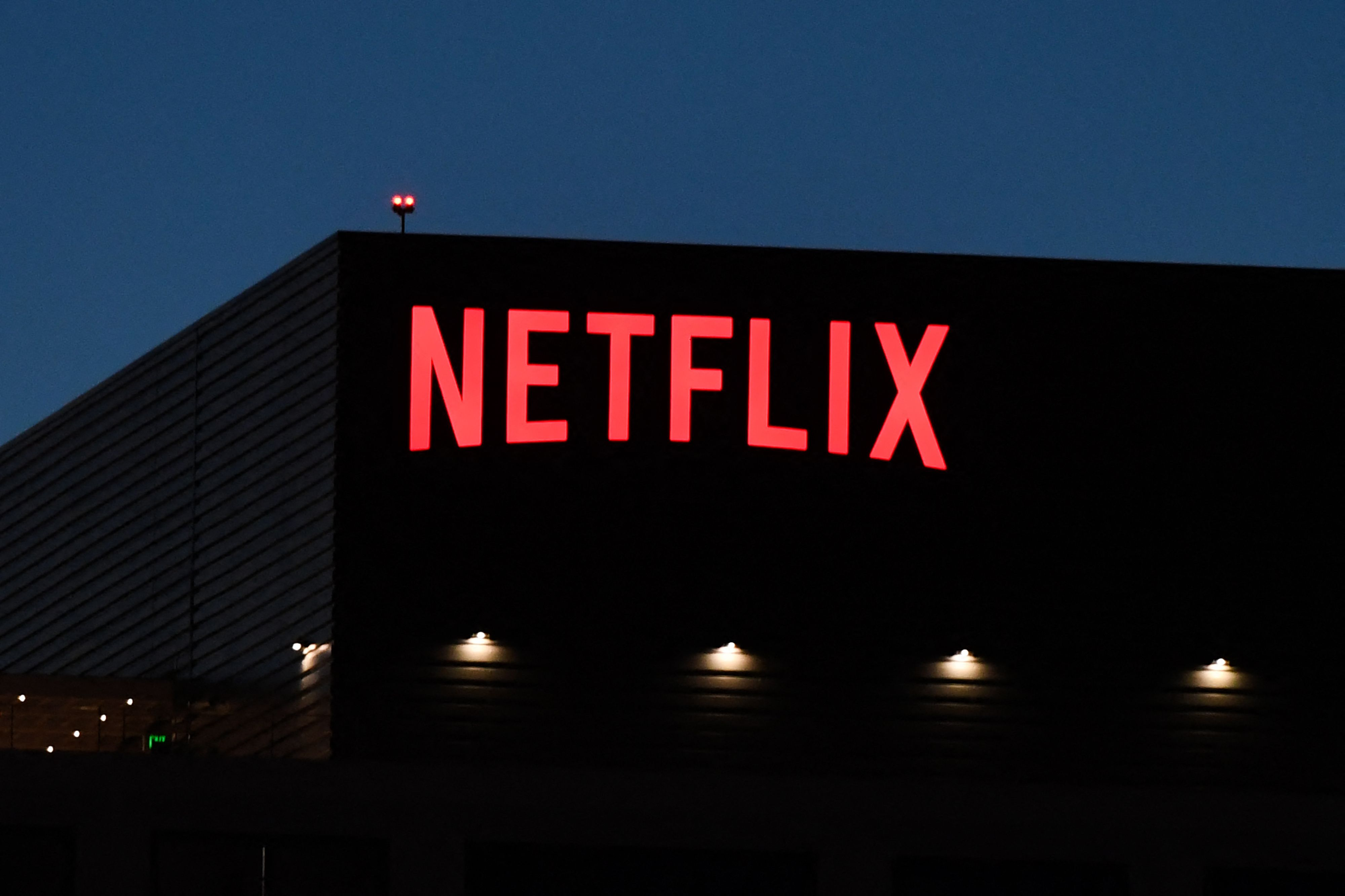 The Netflix logo is seen on the Netflix, Inc. building on Sunset Boulevard in Los Angeles, California