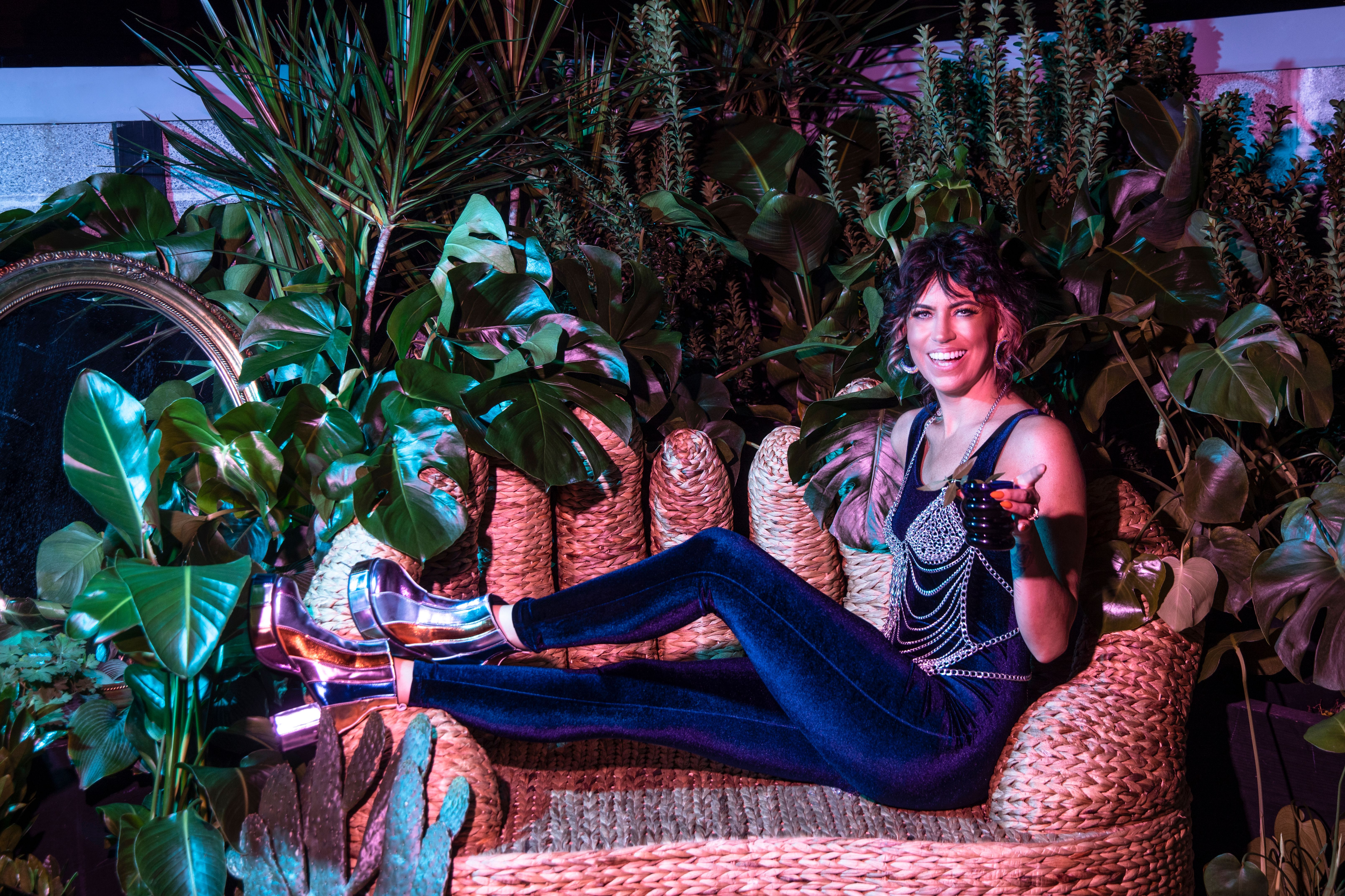 Maria Bastasch poses for a photo on a chais lounge.