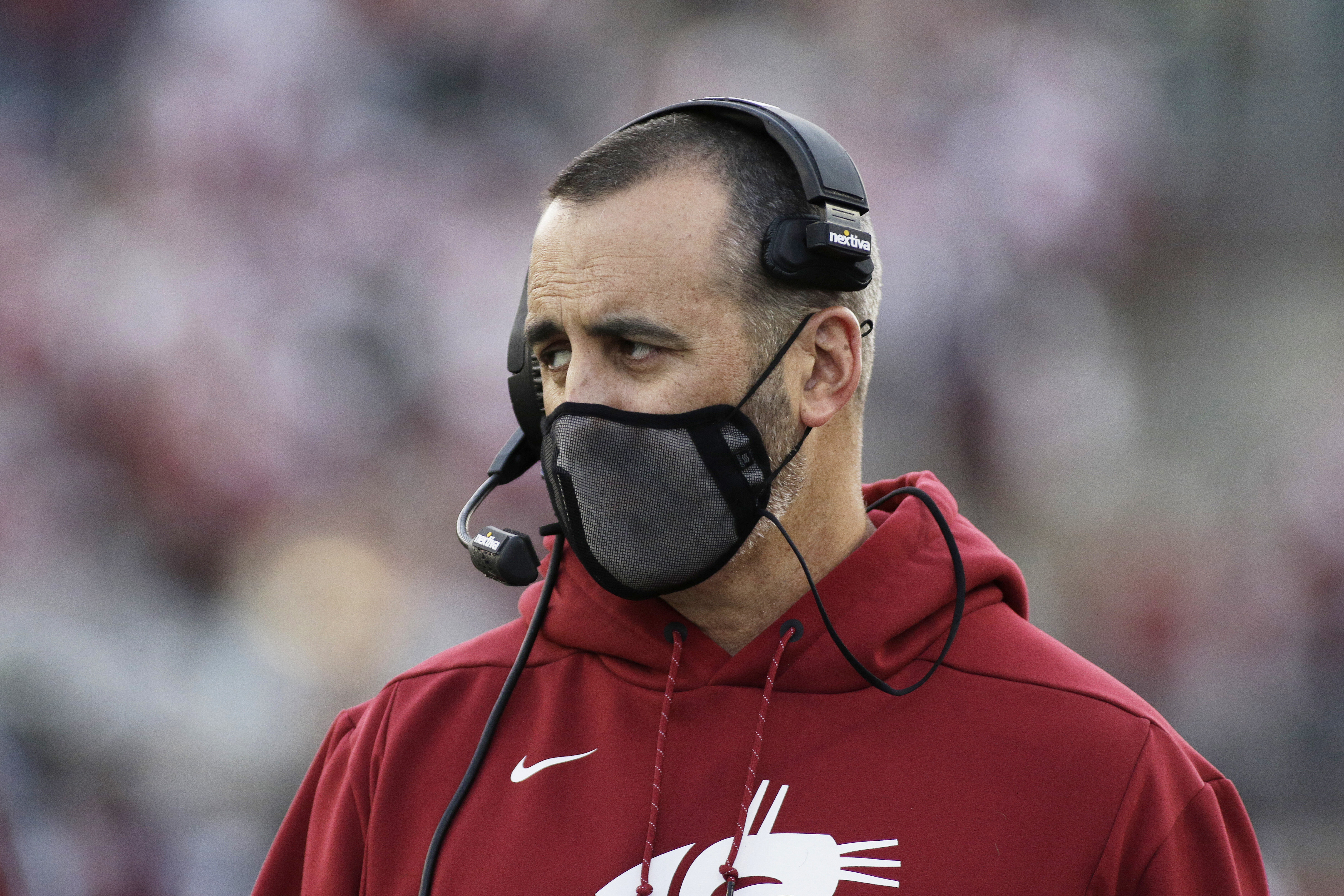 Washington State coach Nick Rolovich coaches against Stanford, Saturday, Oct. 16, 2021, in Pullman, Wash.