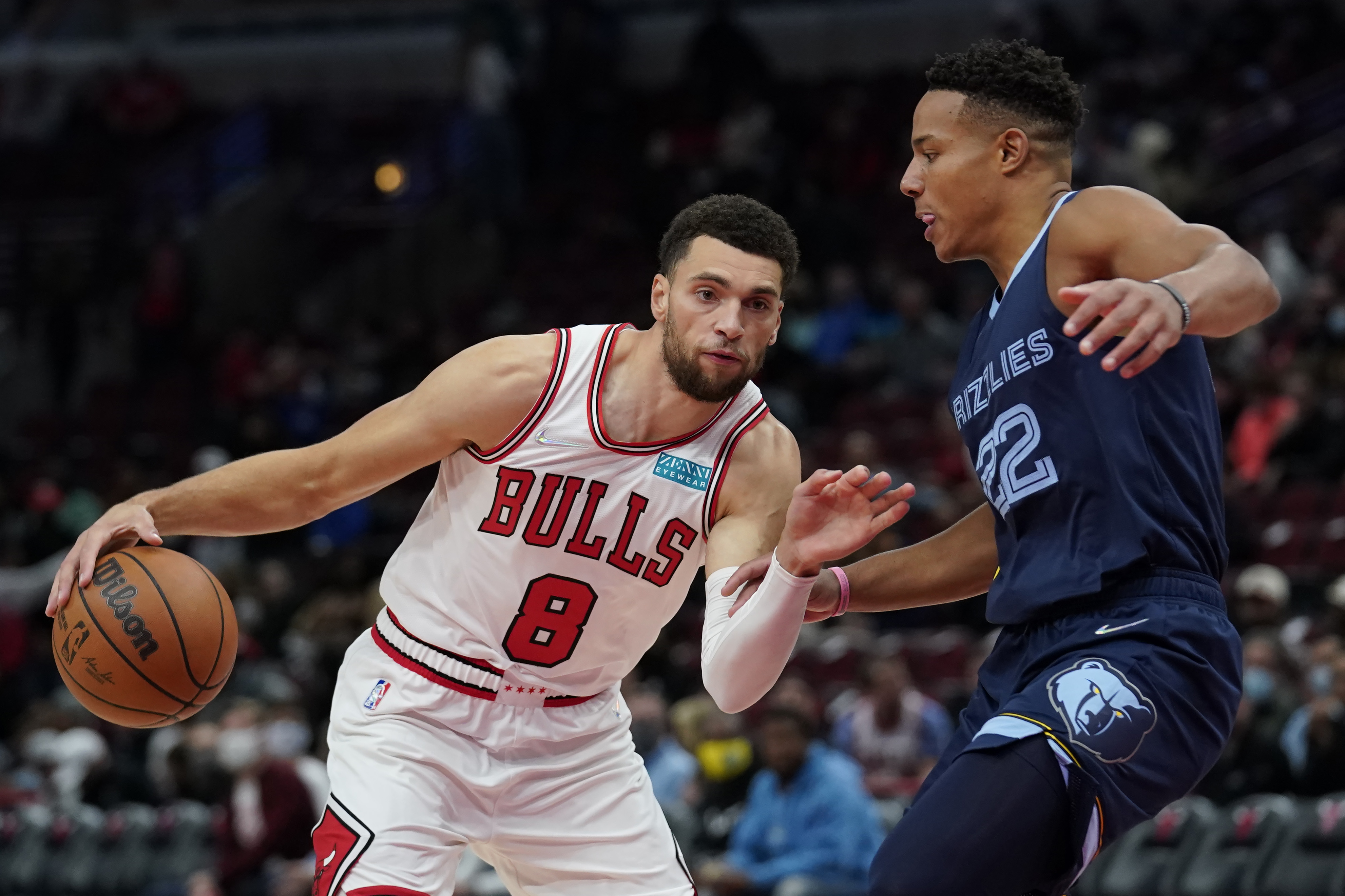 Zach LaVine #8 of the Chicago Bulls dribbles the ball against Desmond Bane #22 of the Memphis Grizzlies in the first half during a preseason game at United Center on October 15, 2021 in Chicago, Illinois.