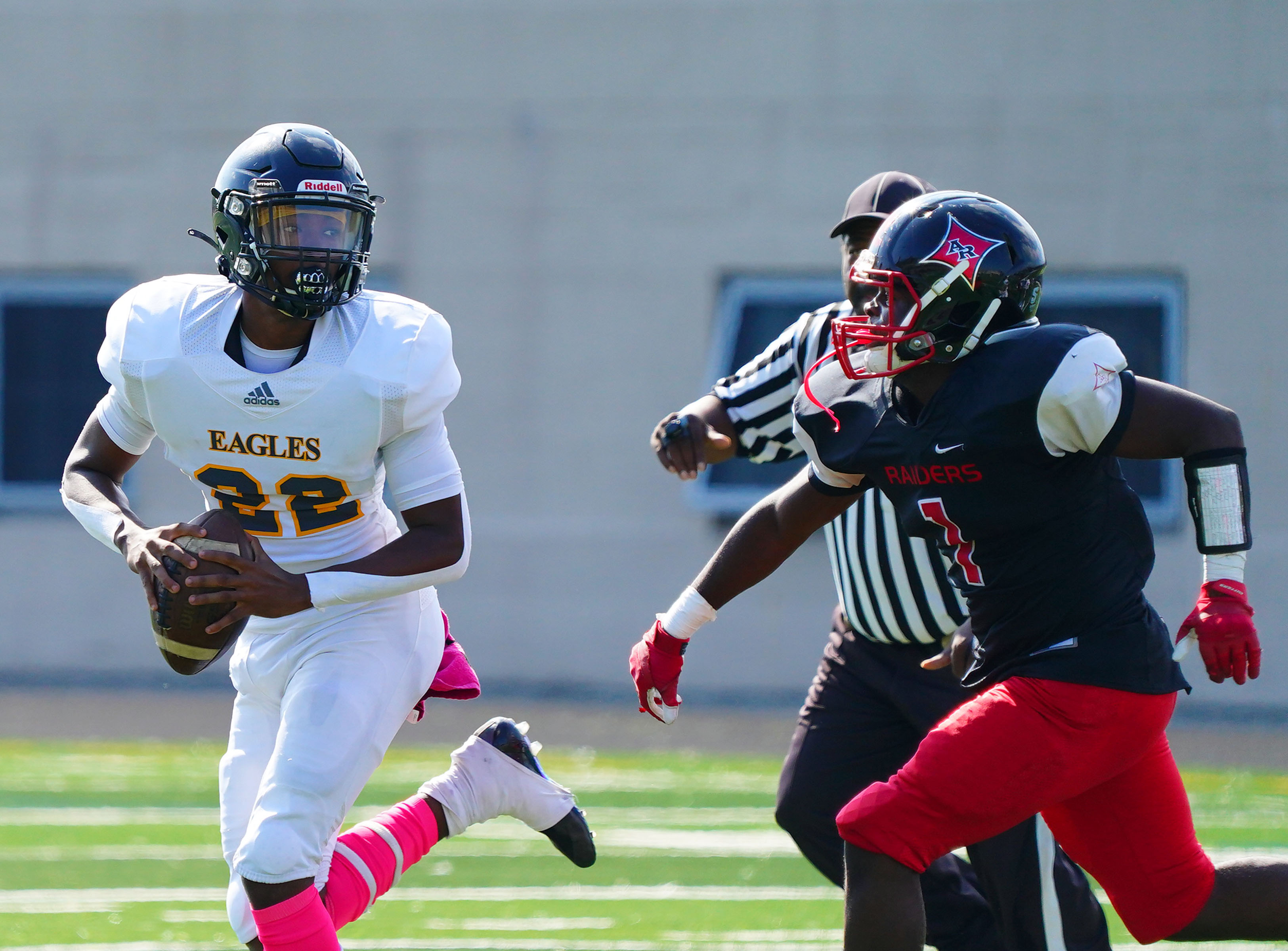 Clark quarterback Dontrell Starks (22) is chased by Rabi's Kierre Turner.