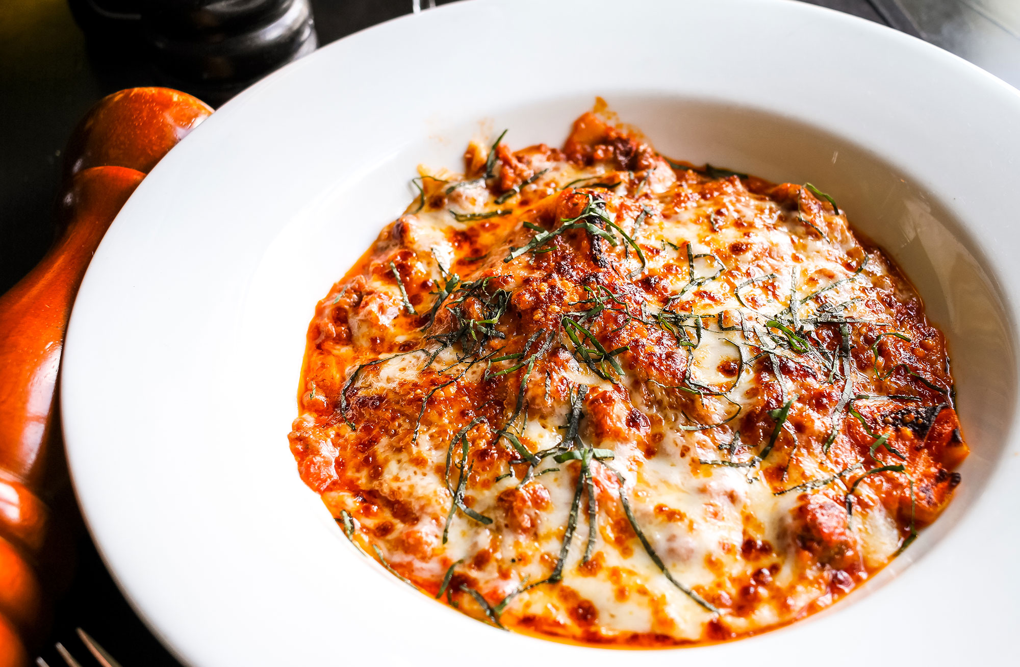 The lasagna matta at Campagnolo in Midtown Atlanta is covered in a thick crust of mozzarella cheese and swimming in tangy red sauce.