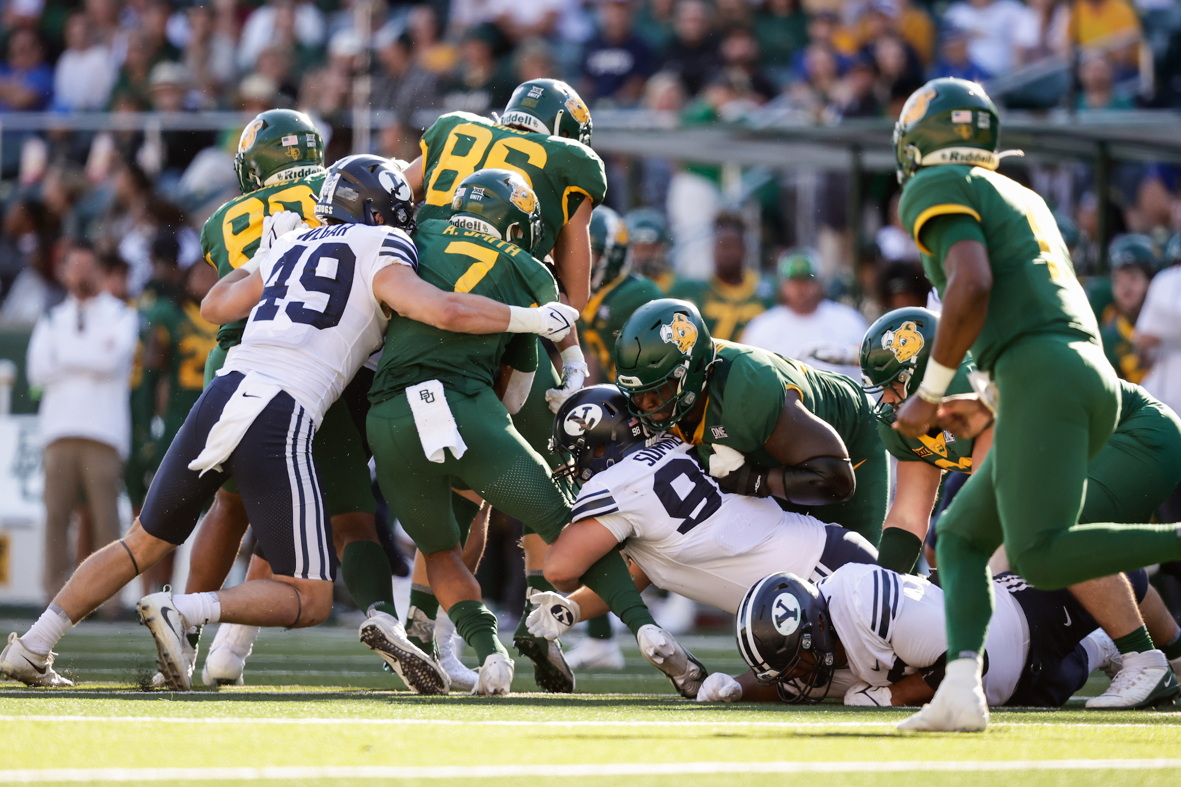 BYU linebacker Payton Wilgar makes a tackle during the Cougars' loss to Baylor in Waco, Texas, on Saturday, Oct. 16, 2021.