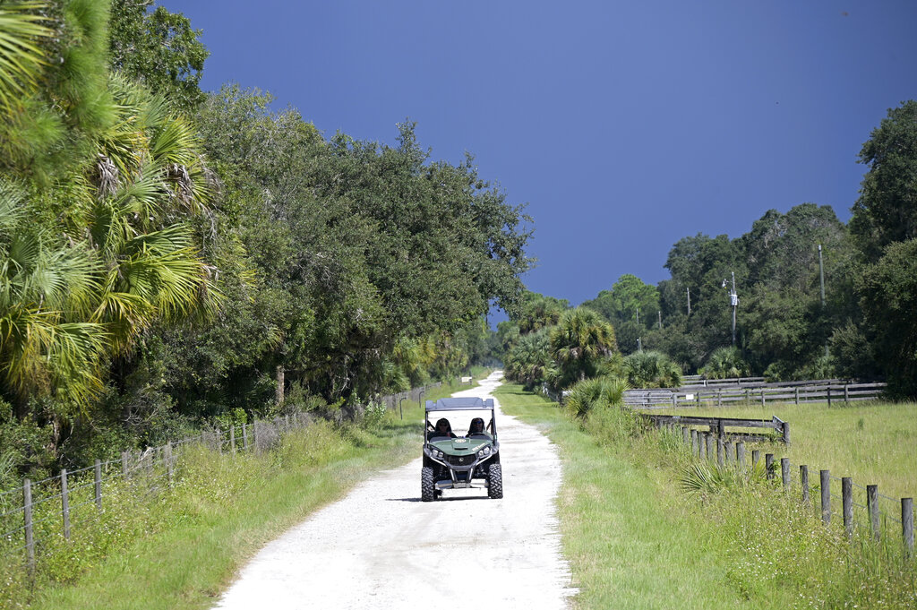 Florida Fish and Wildlife Commission officers drive in the Carlton Reserve.