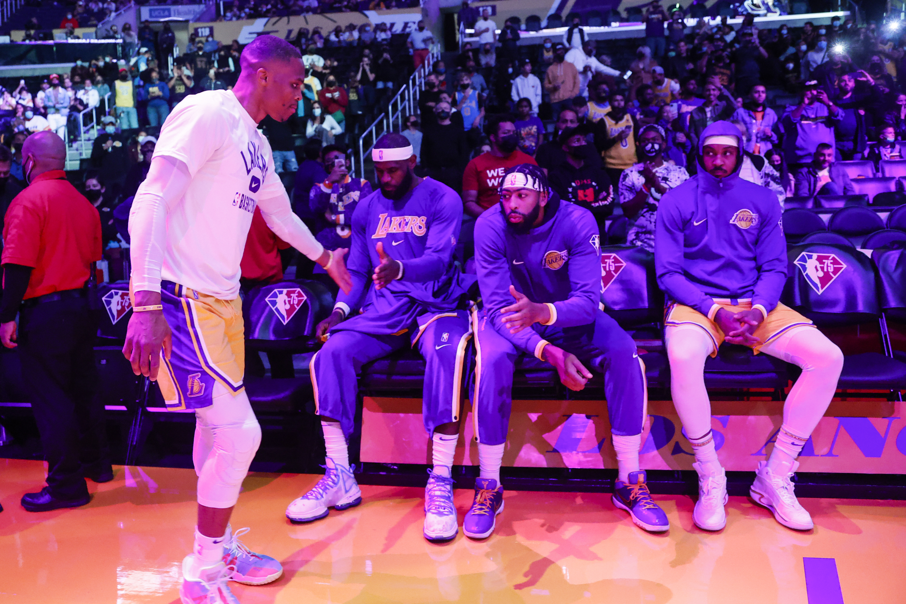 Los Angeles Lakers guard Russell Westbrook greets forwards LeBron James, Anthony Davis and Carmelo Anthony.