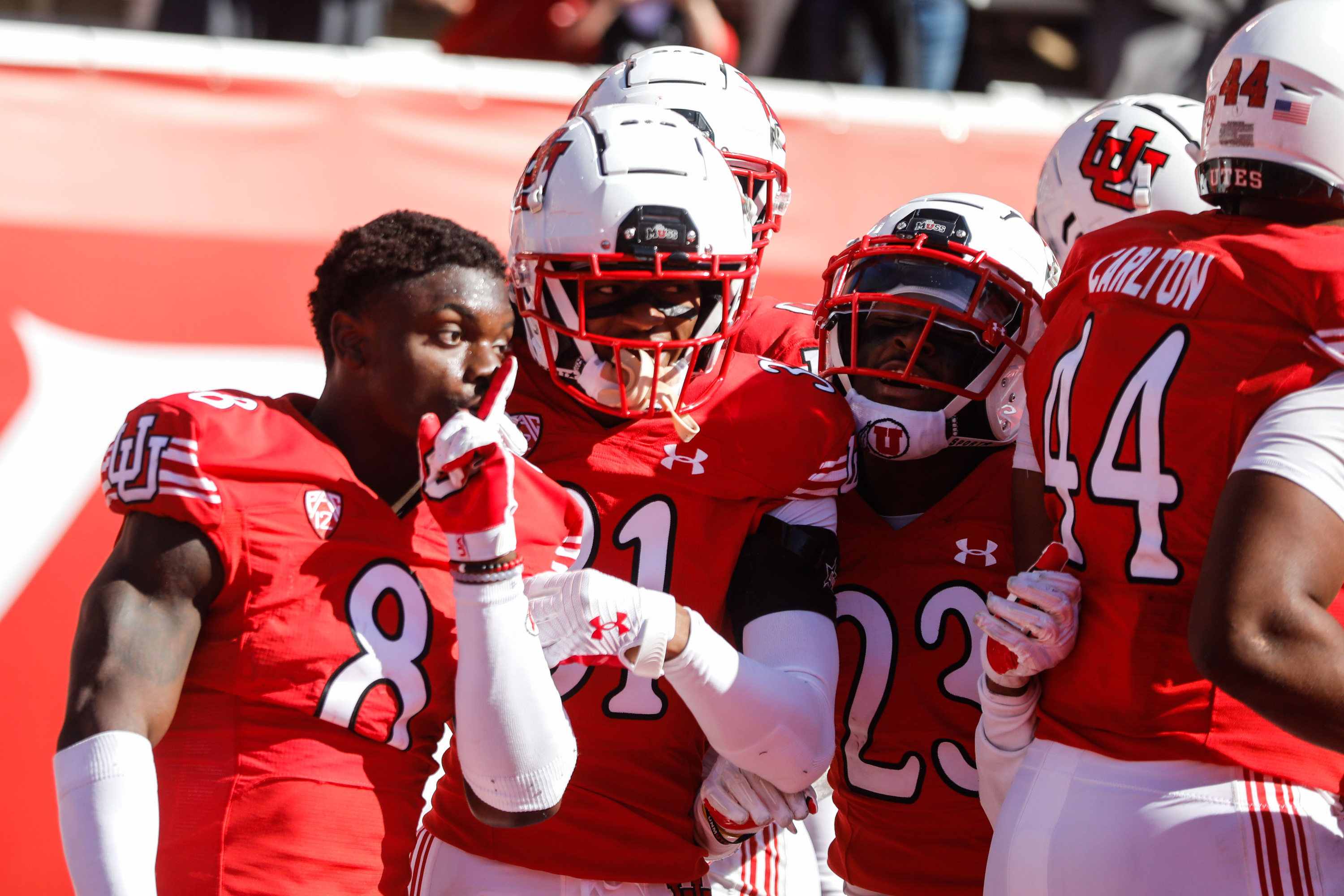 Utah's Clark Phillips III (8) celebrates his pick-six with teammates during game against Washington State in Salt Lake City.