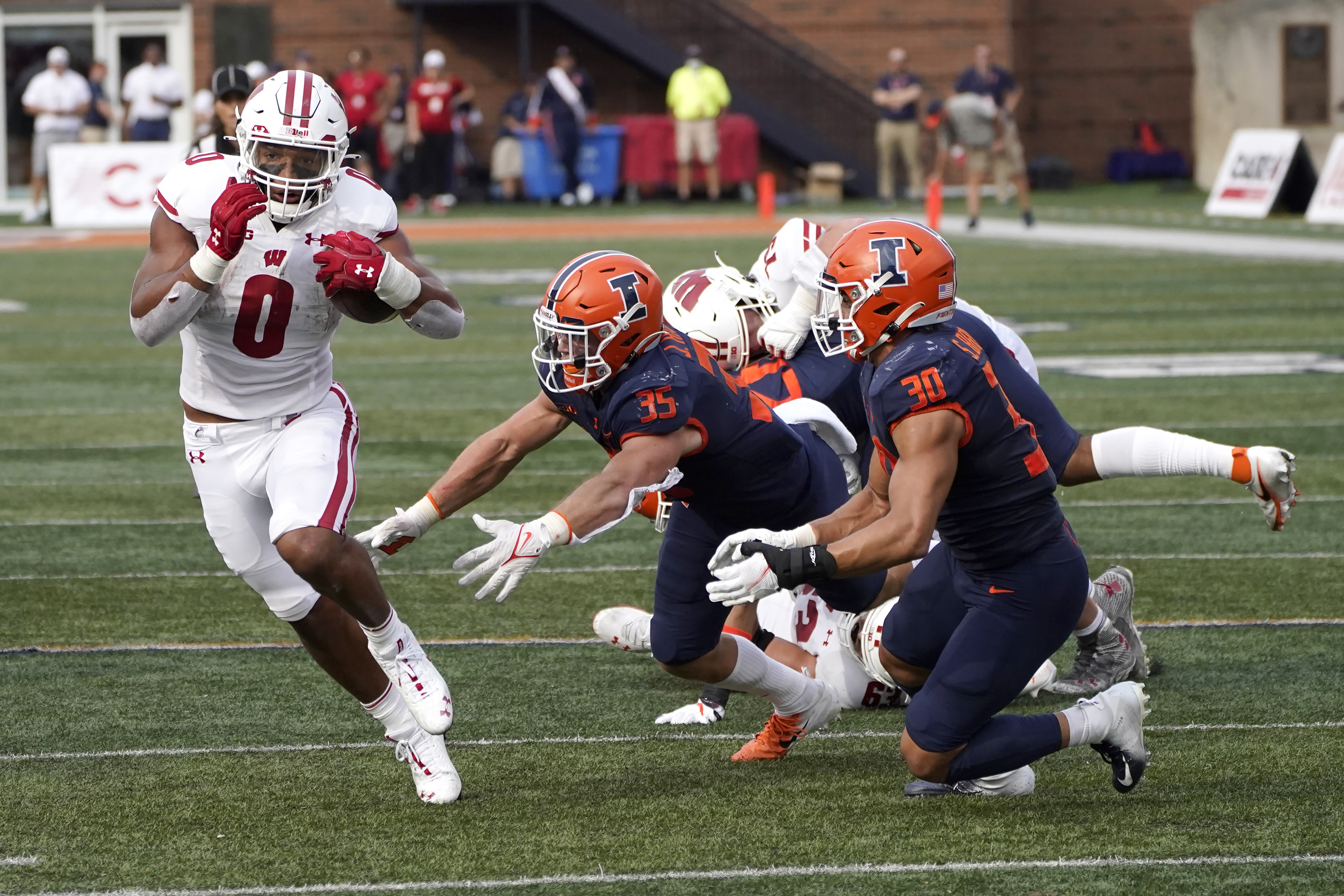 Illinois linebacker Jake Hansen (middle) will miss the rest of the season.