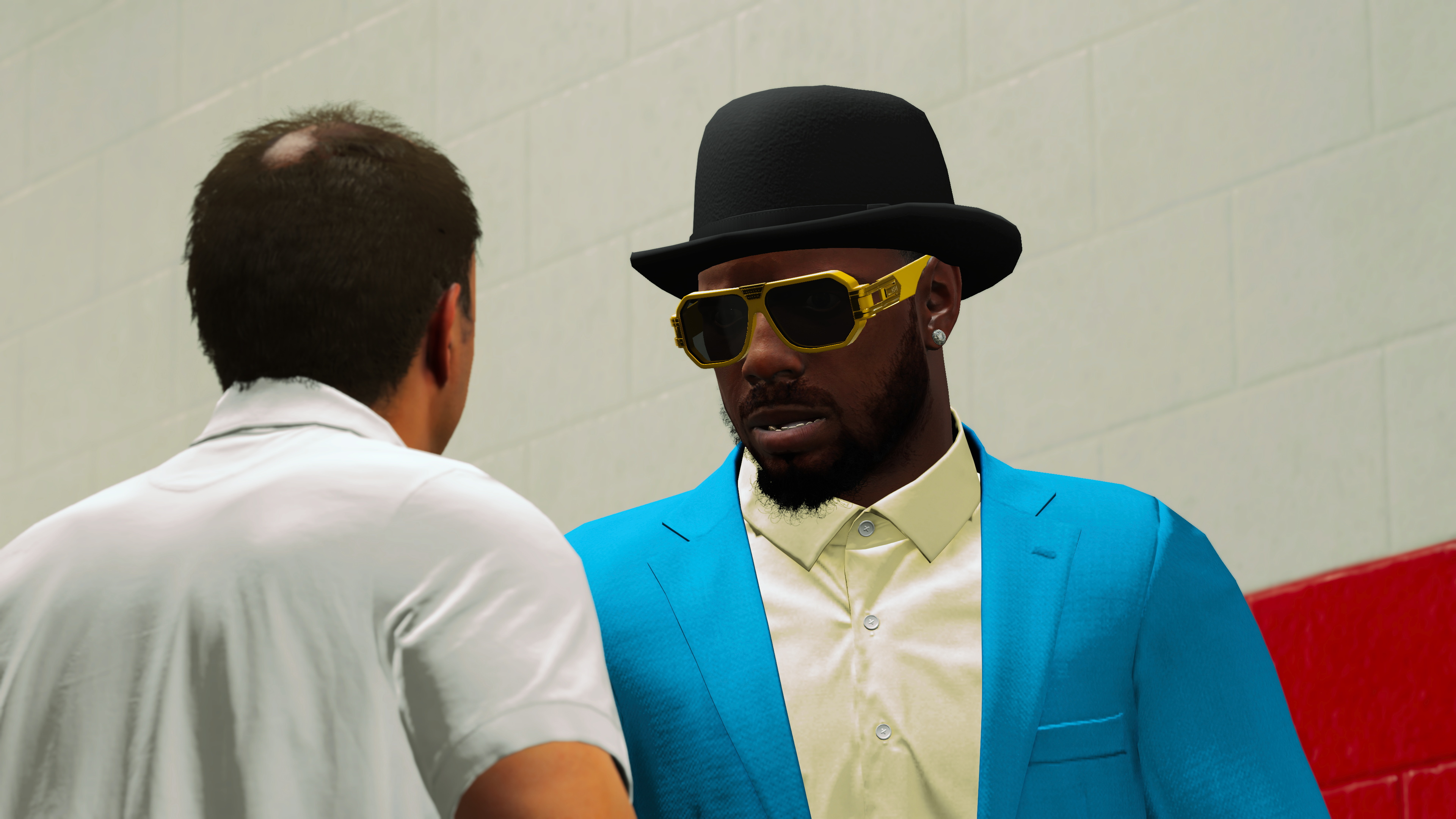 a guy in a white shirt with a bald spot on the back of his head talks to a large NBA player in flashy street clothes and garish sunglasses