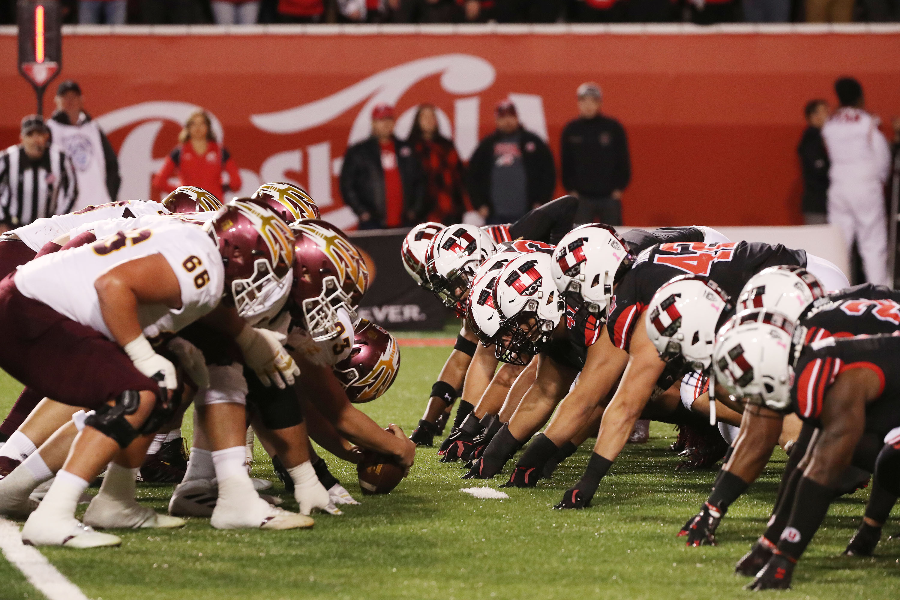 The Utah Utes and Arizona State Sun Devils line faces each other before a snap