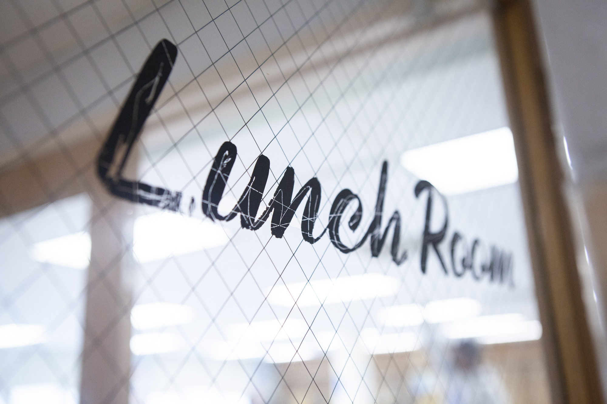A door that is labeled Lunch Room.