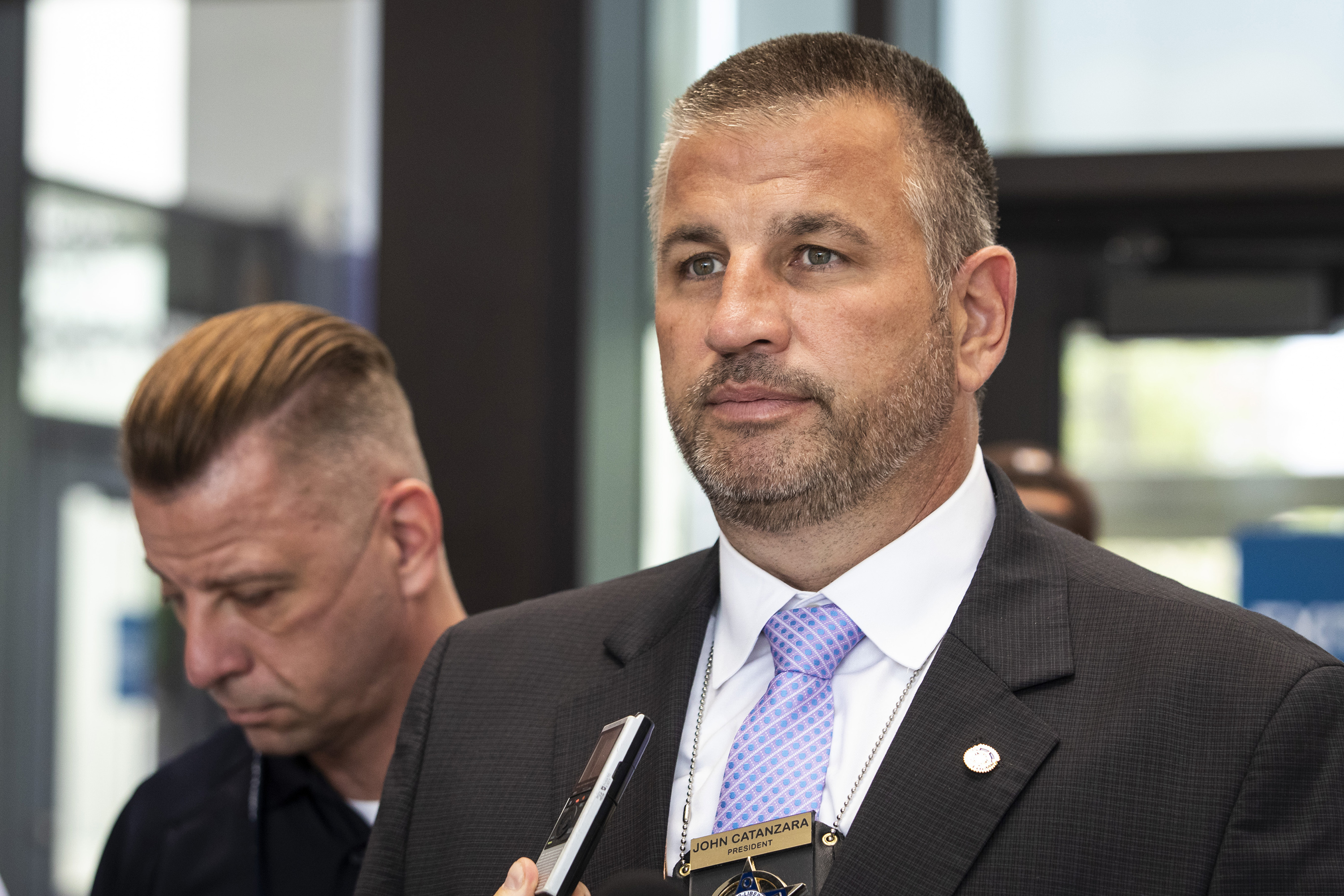 In this Aug. 10, 2021, file photo, Fraternal Order of Police Lodge 7 President John Catanzara speaks to reporters at the Leighton Criminal Courthouse.
