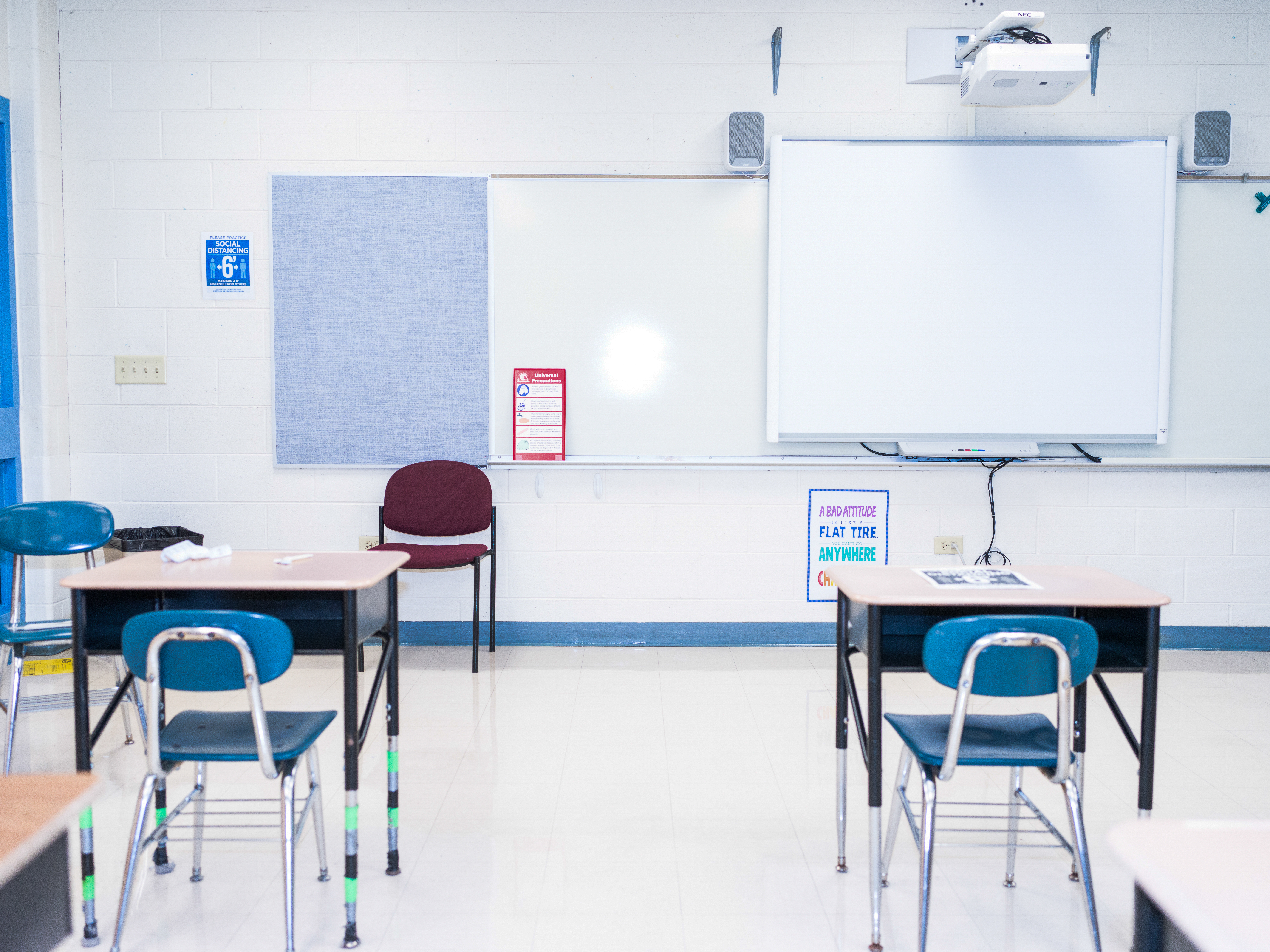 Empty desks and posters promoting social distancing at Lincoln Elementary in Dolton, Illinois, on Feb. 28, 2021.