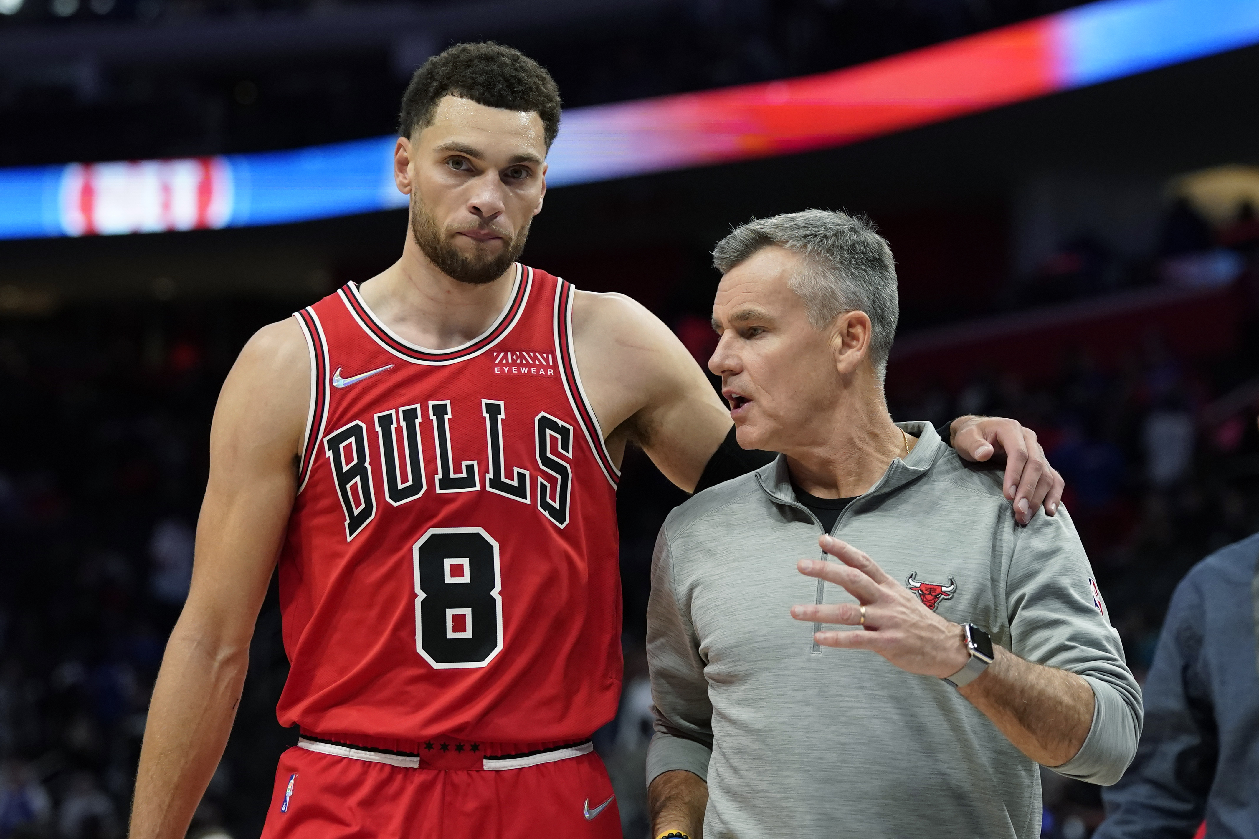 Bulls guard Zach LaVine walks off the court with head coach Billy Donovan after Wednesday's win over the Pistons.