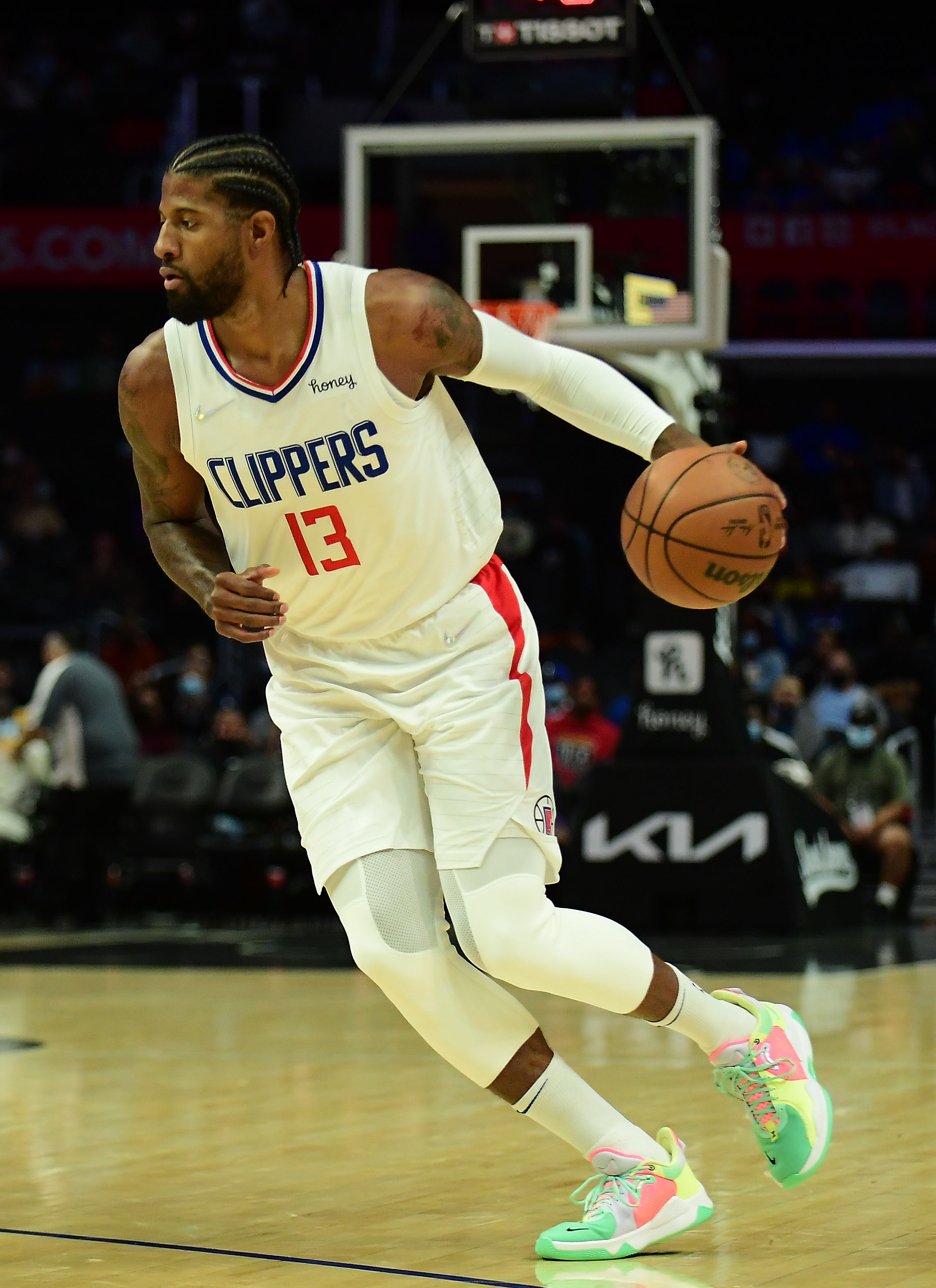 Los Angeles Clippers guard Paul George (13) controls the ball against the Sacramento Kings during the first half at Staples Center.