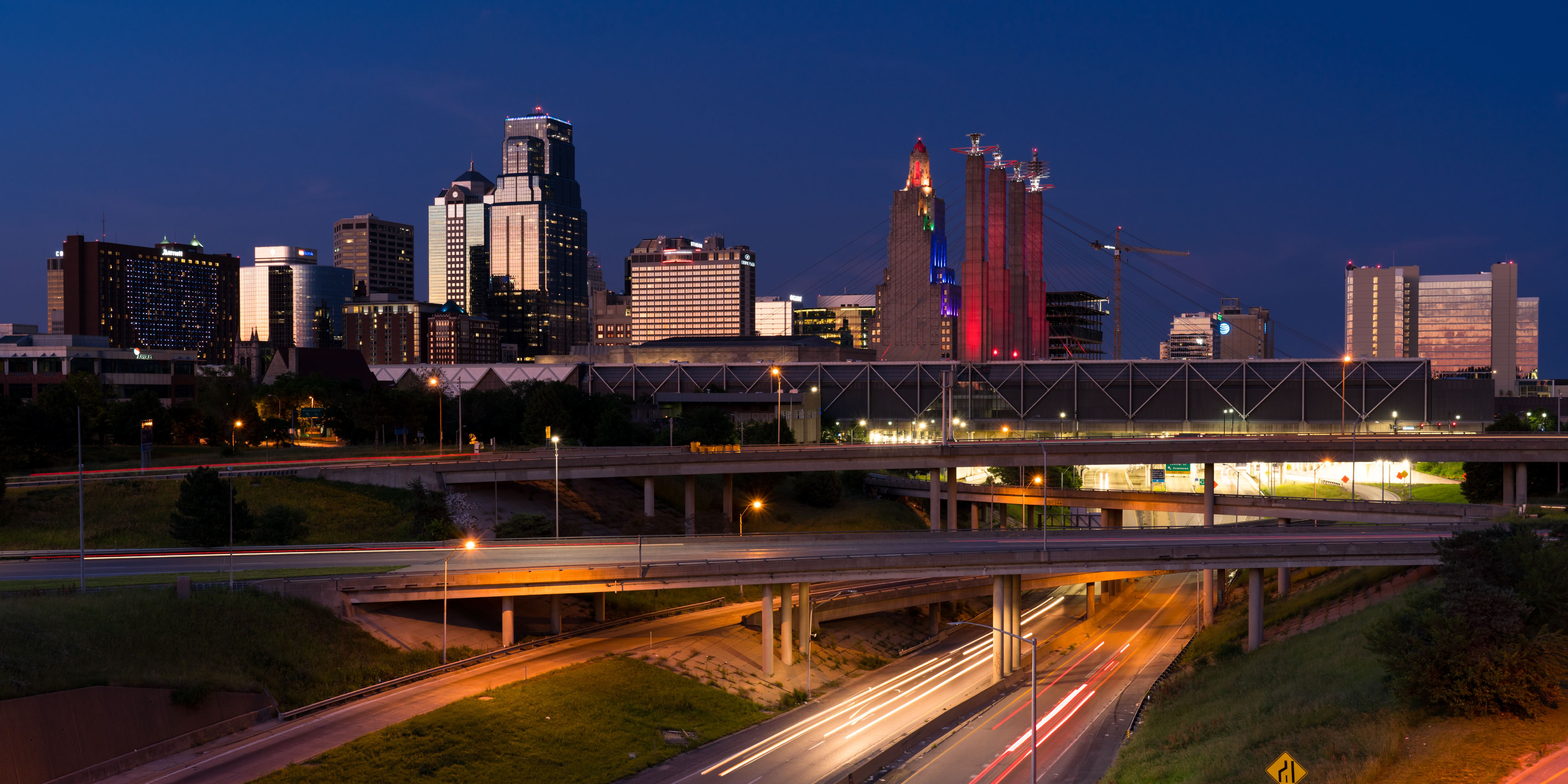 Kansas City Skyline at dusk with traffic and streaked lights and car trails, Missouri