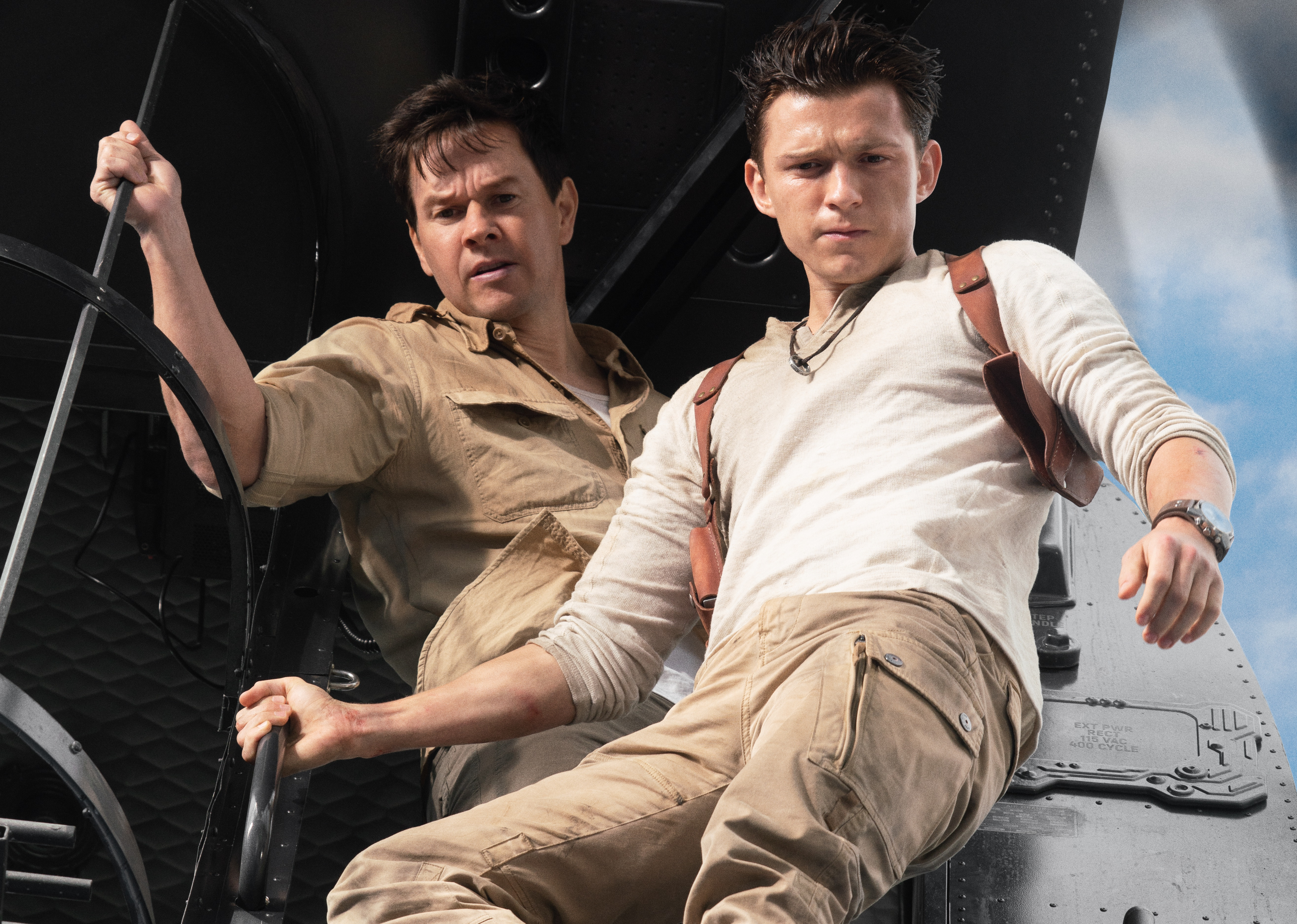 Tom Holland as Nathan Drake and Mark Wahlberg as other guy in Uncharted