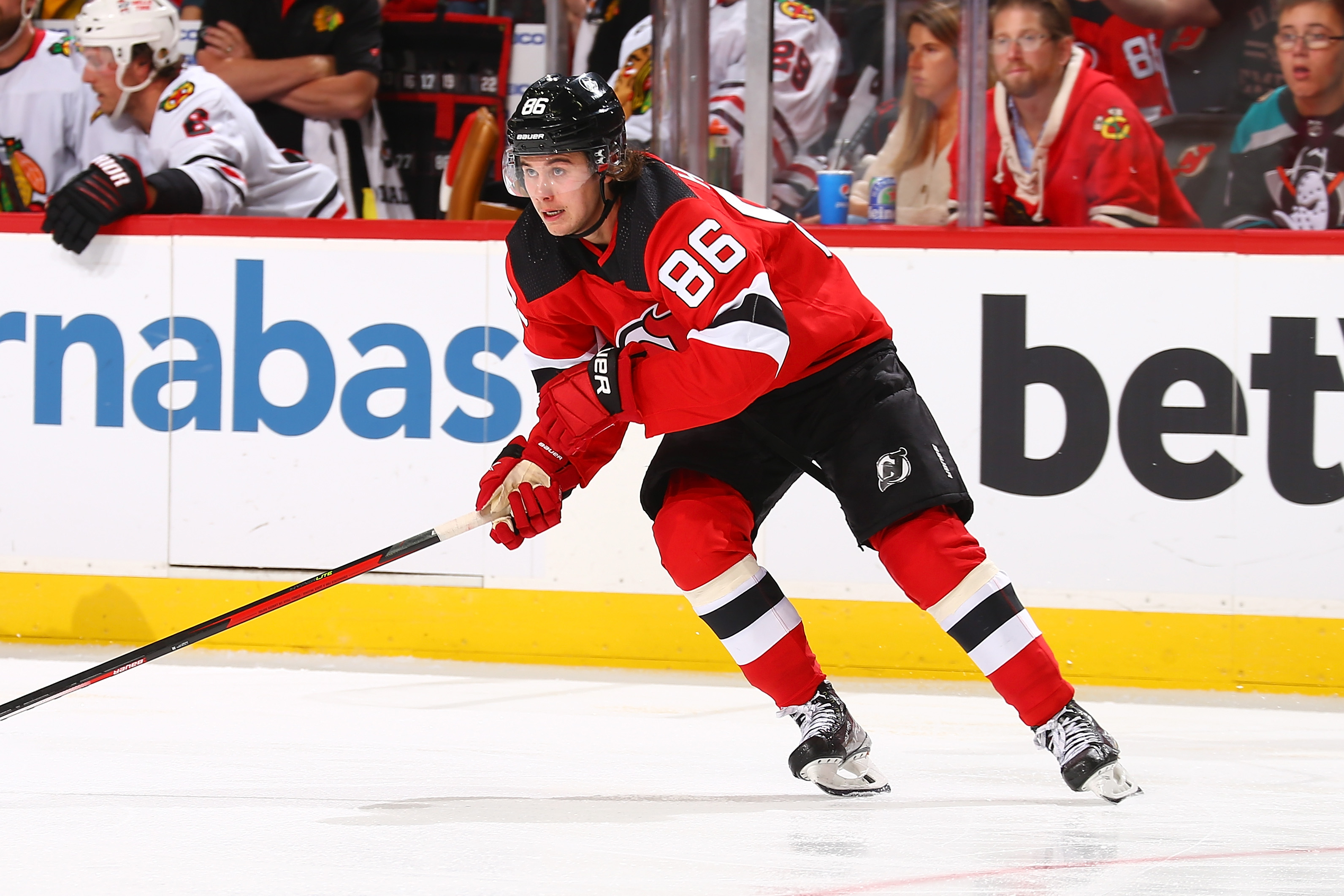 Jack Hughes #86 of the New Jersey Devils in action against the Chicago Blackhawks at Prudential Center on October 15, 2021 in Newark, New Jersey. New Jersey Devils defeated the Chicago Blackhawks 4-3 in OT.