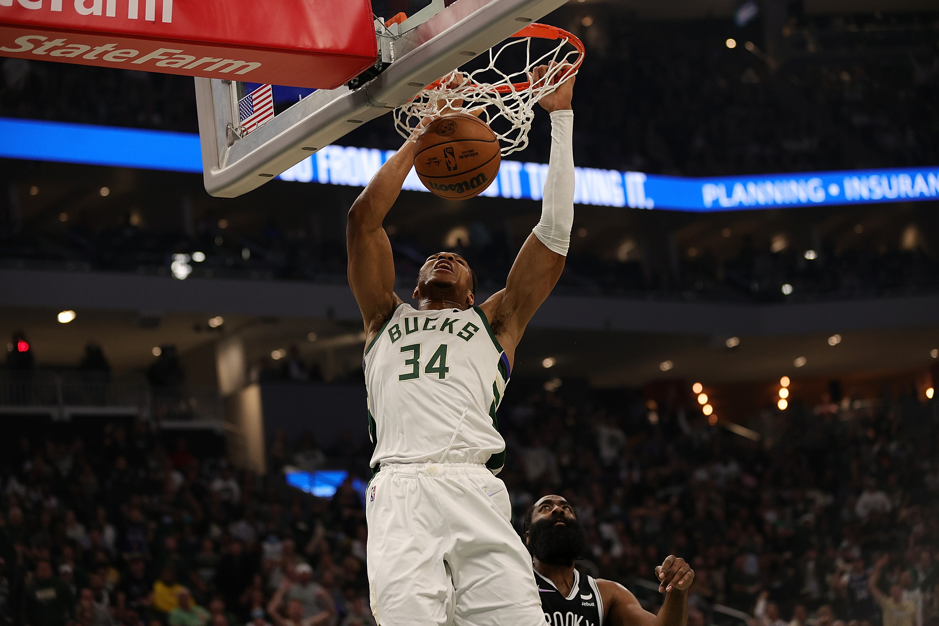 Giannis Antetokounmpo #34 of the Milwaukee Bucks dunks against the Brooklyn Nets during the first half of the season opener at the Fiserv Forum on October 19, 2021 in Milwaukee, Wisconsin.