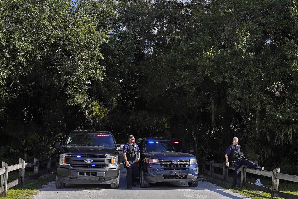 North Port police officers block the entrance to the Myakkahatchee Creek Environmental Park.