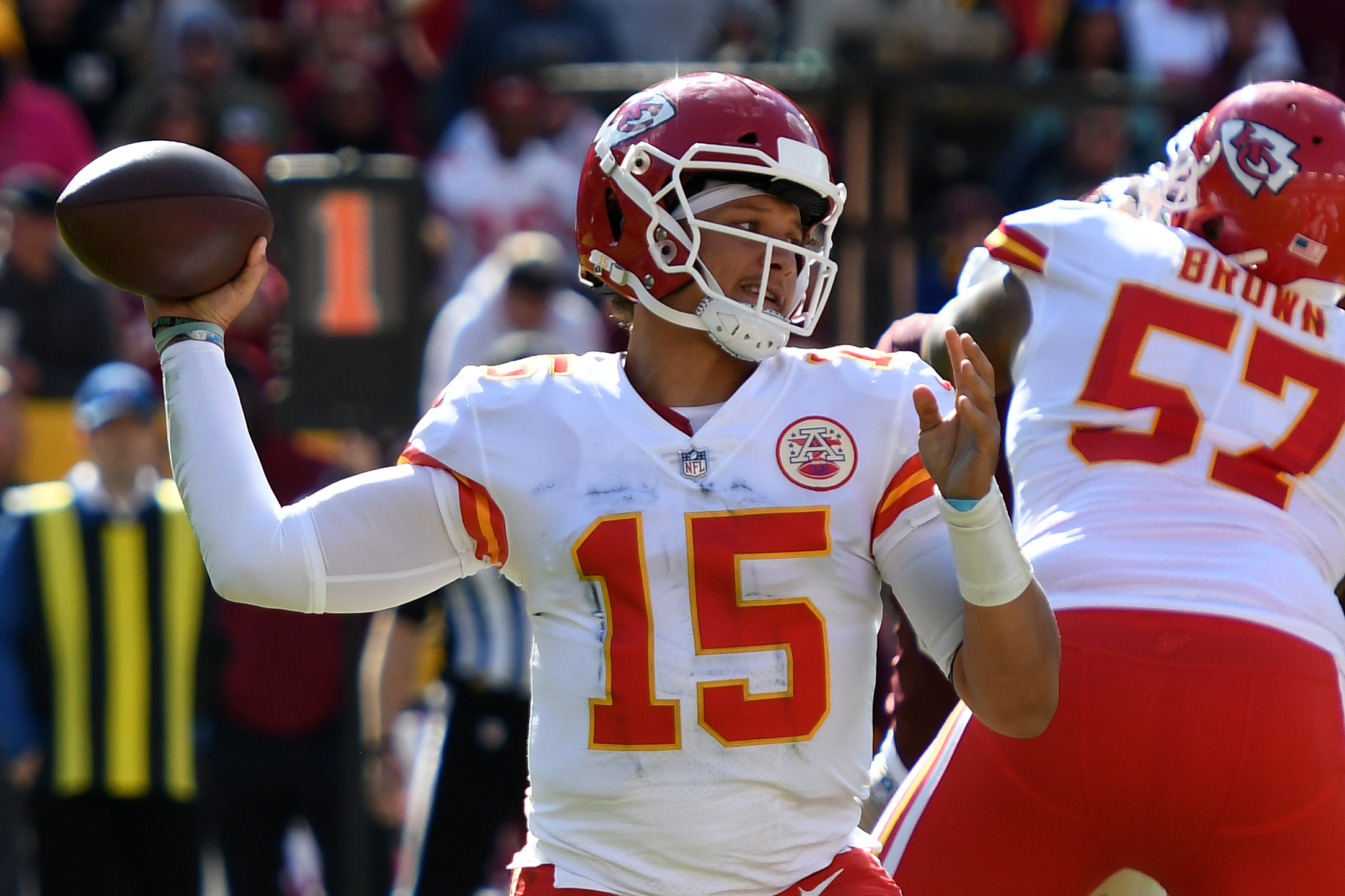 Patrick Mahomes #15 of the Kansas City Chiefs looks to throw the ball during the first half against the Washington Football Team at FedExField on October 17, 2021 in Landover, Maryland.