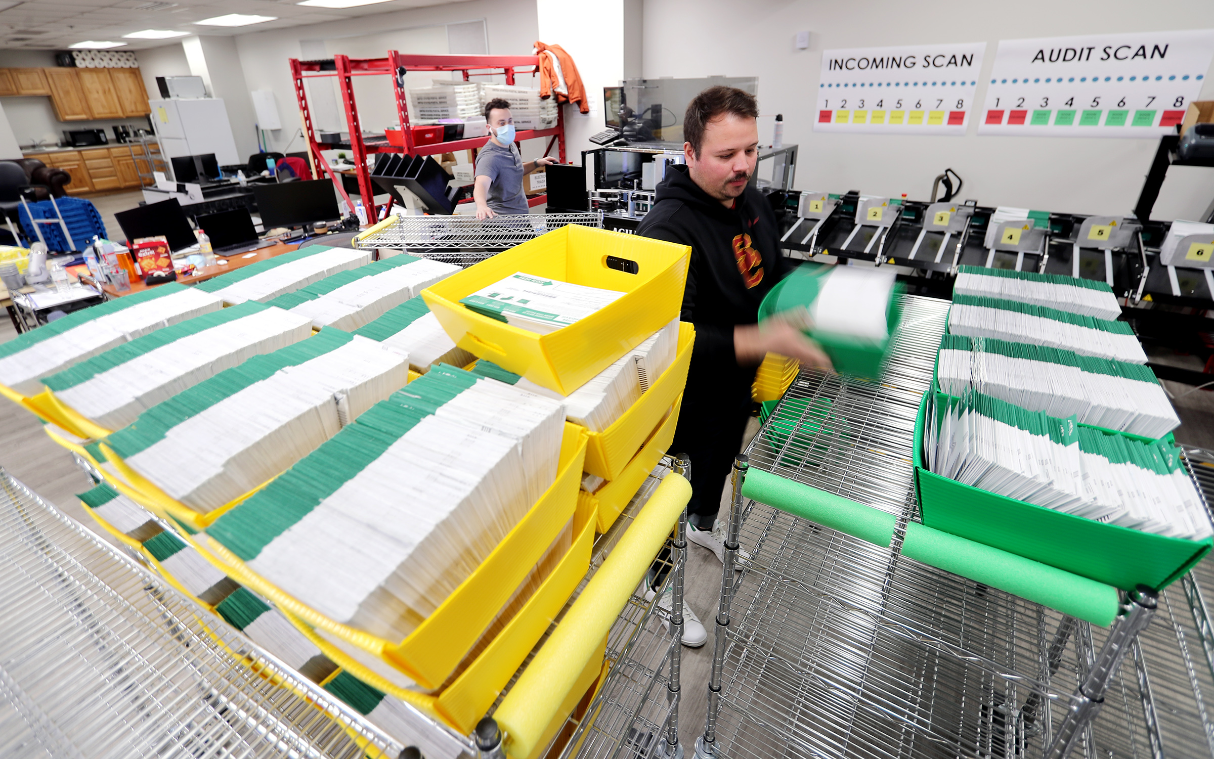 Election ballots are processed by workers at the Utah County Clerk/Auditor's Office in Provo on Tuesday, Oct. 27, 2020.