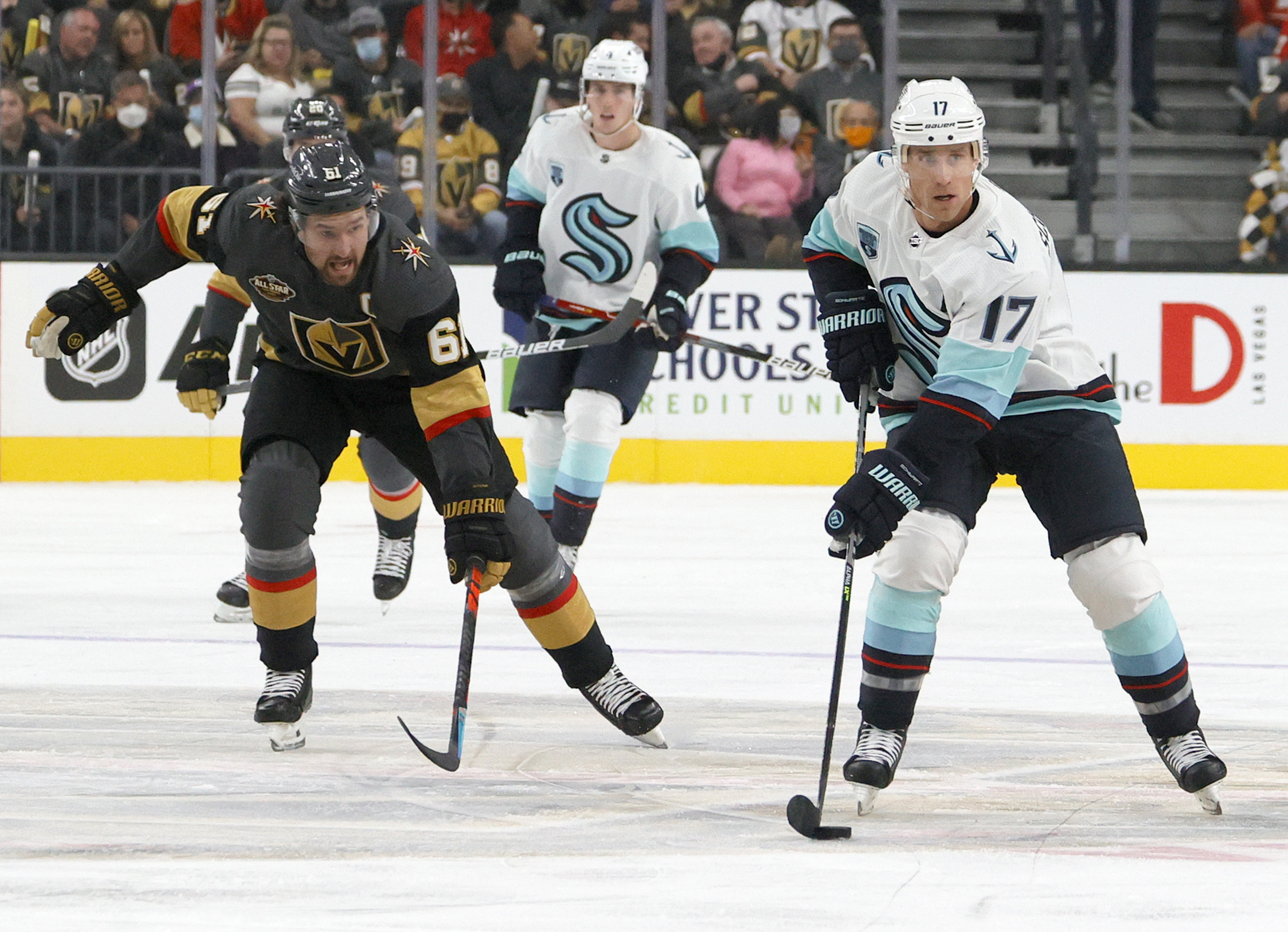 Jaden Schwartz #17 of the Seattle Kraken skates with the puck against Mark Stone #61 of the Vegas Golden Knights in the first period of the Kraken's inaugural regular-season game at T-Mobile Arena on October 12, 2021 in Las Vegas, Nevada. The Golden Knights defeated the Kraken 4-3.