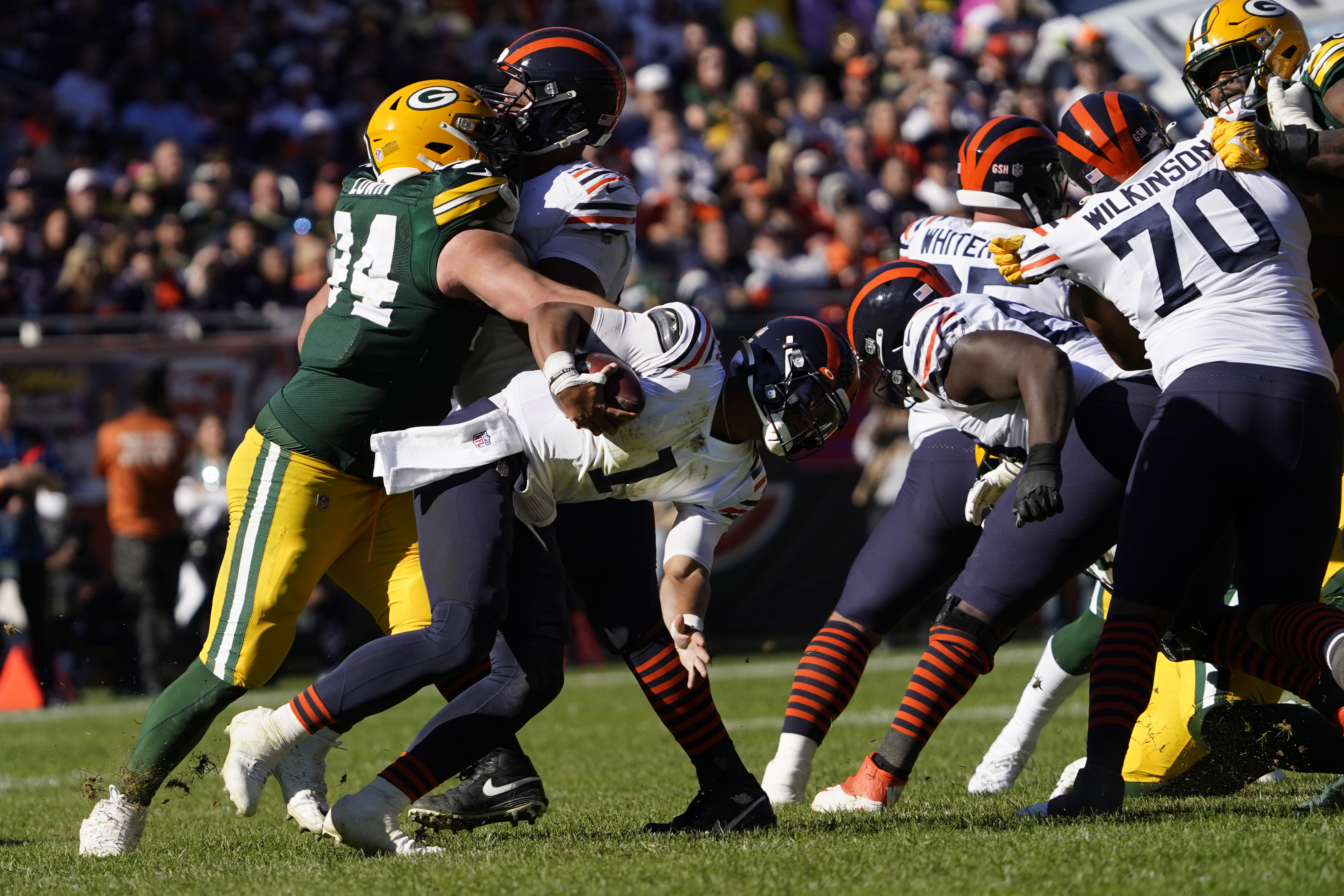 Bears rookie quarterback Justin Fields (1) was sacked four times last week in a 24-14 loss to the Packers at Soldier Field.