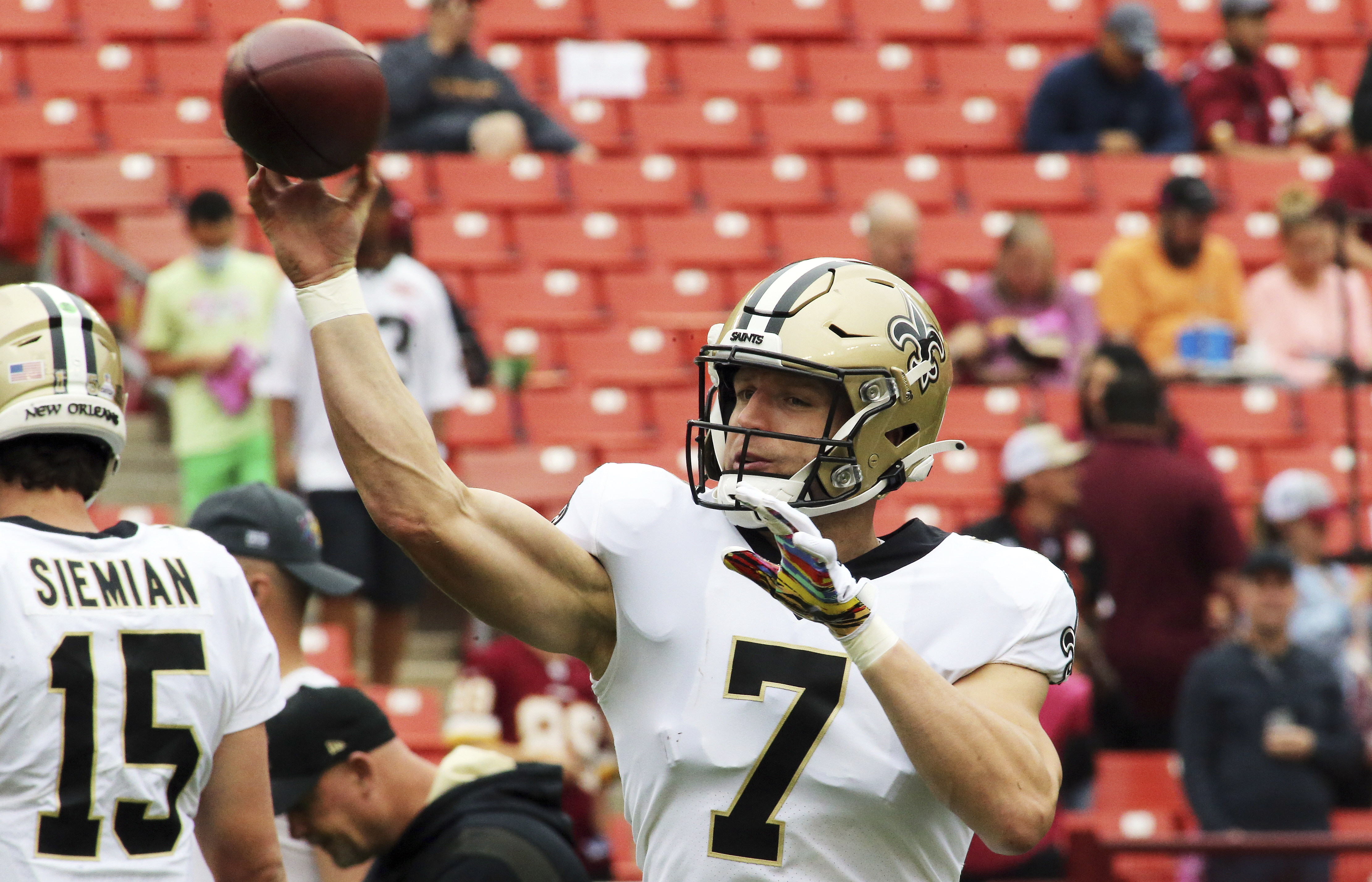 New Orleans Saints quarterback Taysom Hill (7) throws before during an NFL football game against the Washington Football Team.