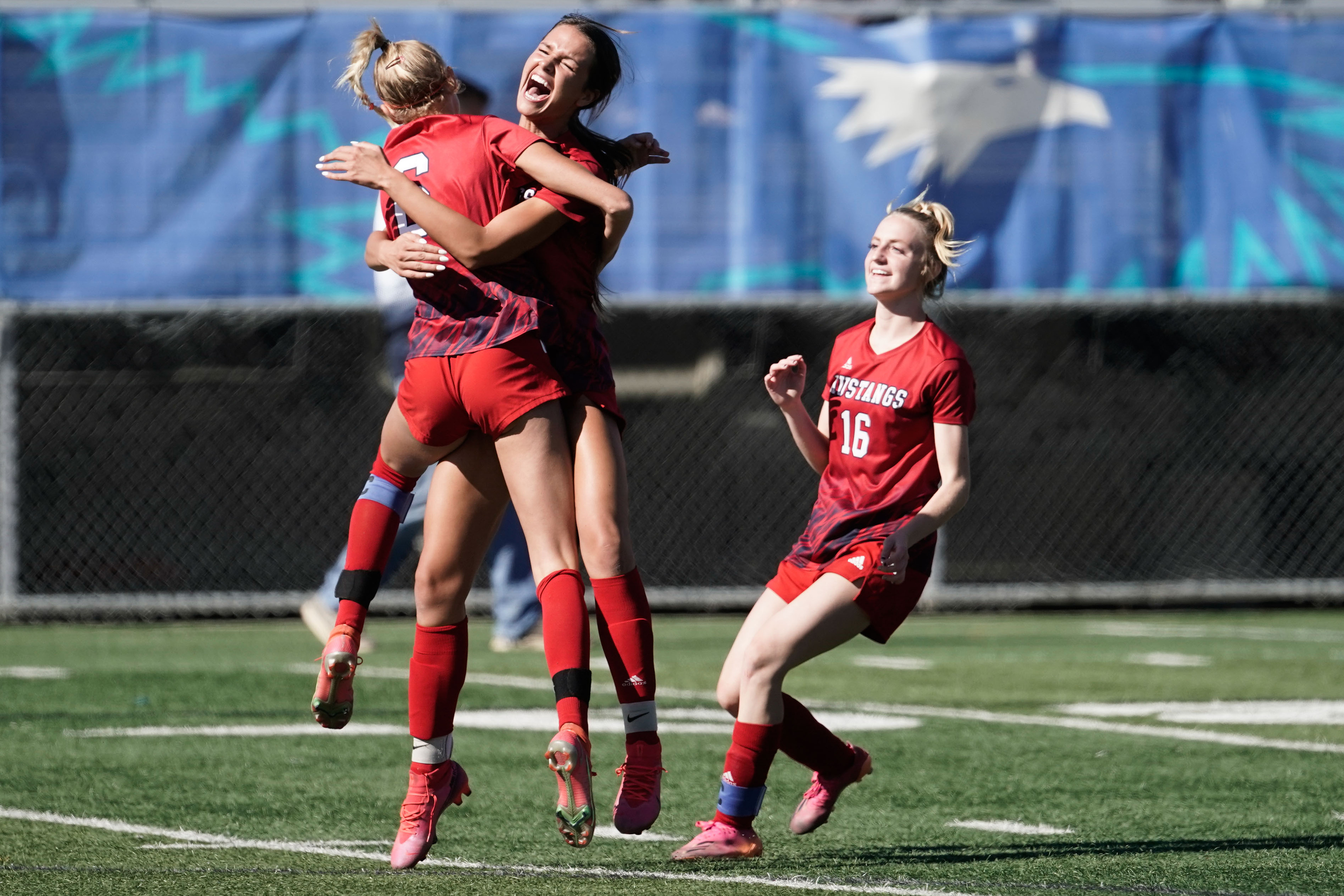 Crimson Cliffs players celebrate their victory against Sky View High in the 4A girls soccer state semifinal game at Juan Diego Catholic High School in Draper.