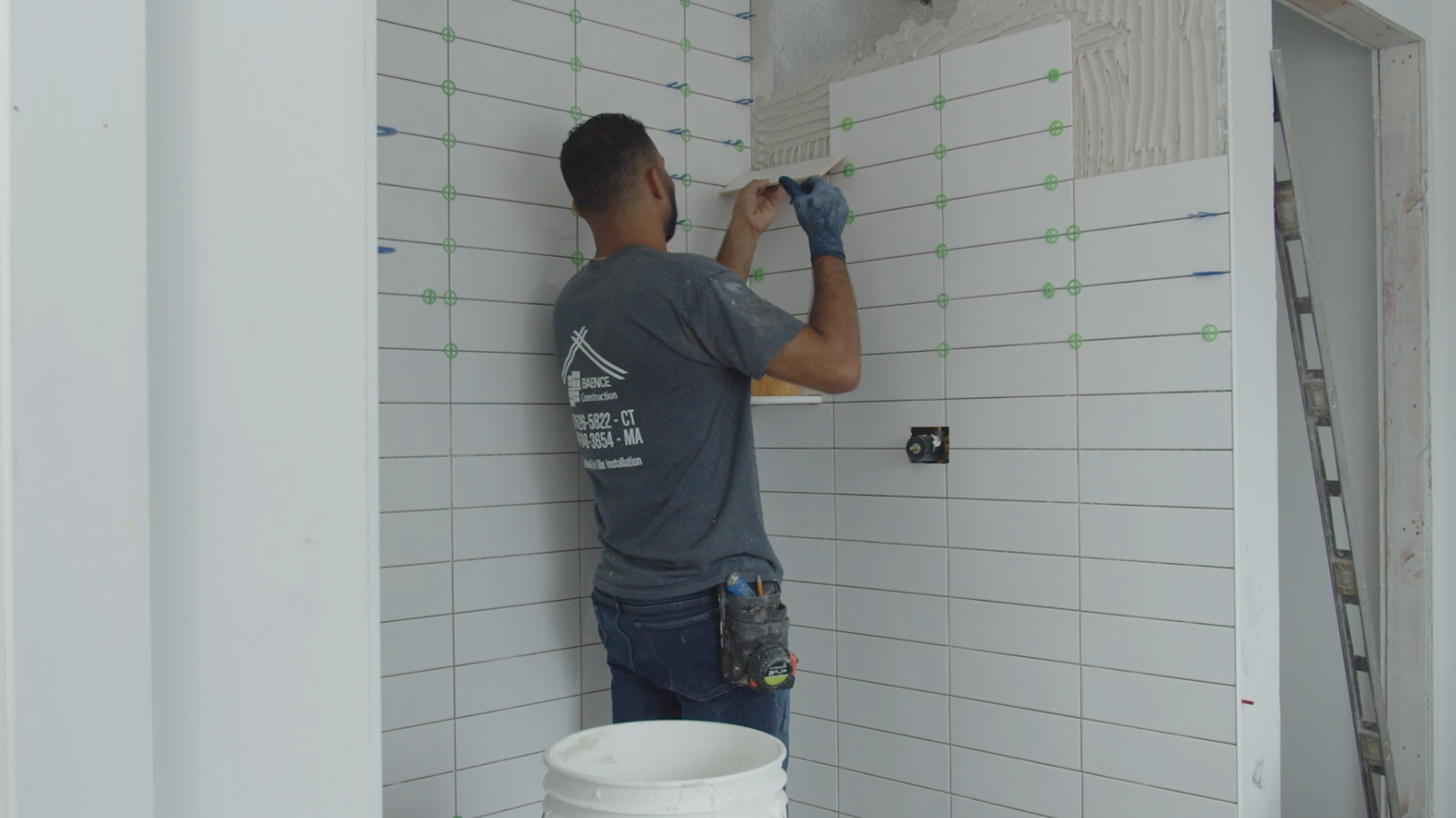Tiling the bathroom at the 2021 Idea House, the Cottage Community