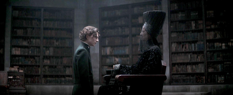 Paul Atreides knees before the Bene Gesserit Reverend Mother Gaius Helen Mohaim in Dune.