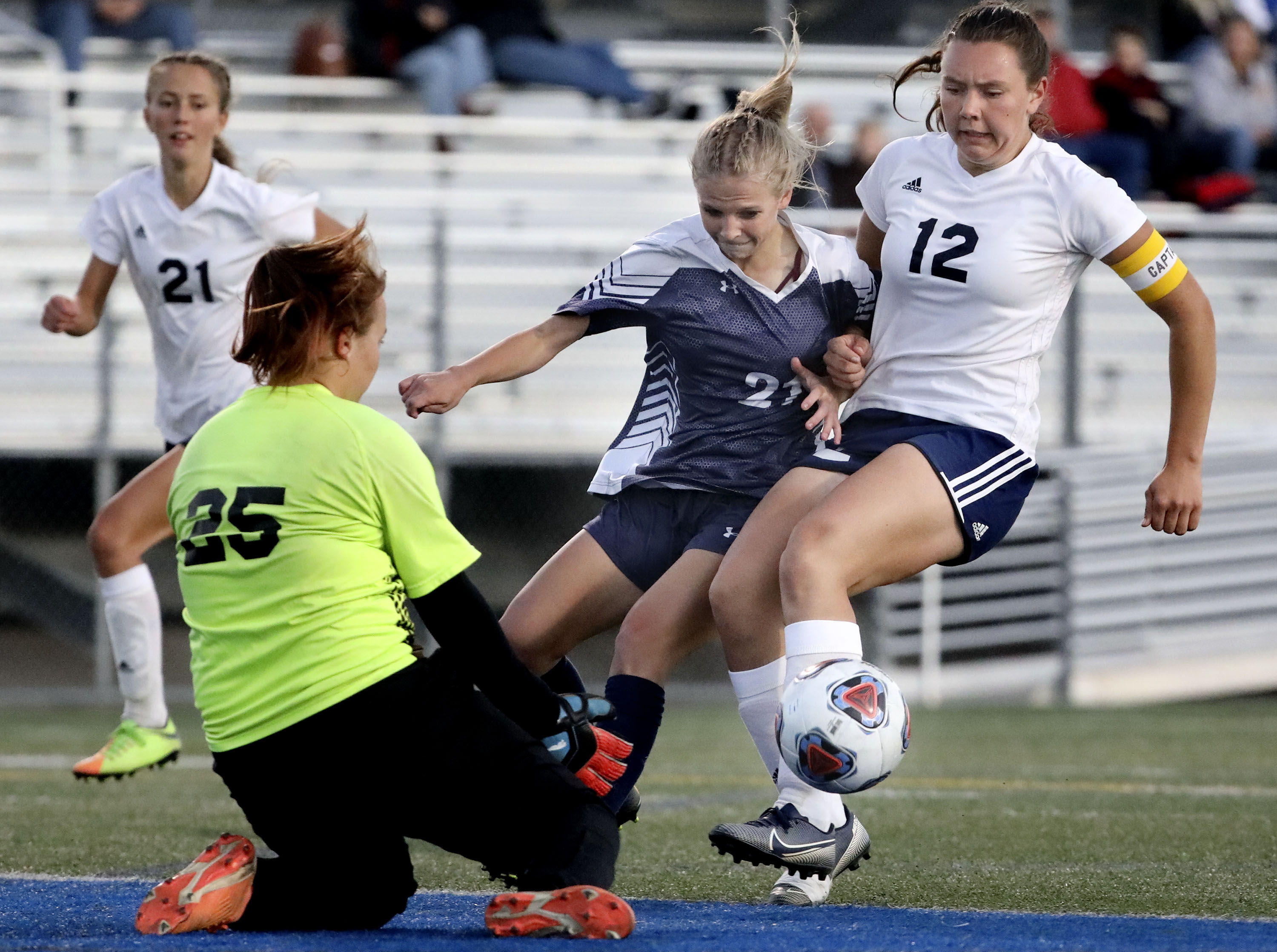 Waterford's Grace Morris tries to score against Millard's Lucy Freeman and Hannah Koyle in the 2A girls soccer semifinals.