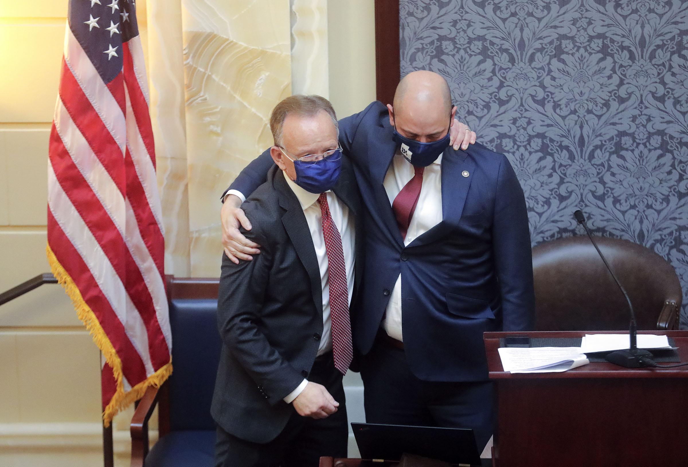 Utah Senate President Stuart Adams, R-Layton, left, hugs Dan Hemmert, director of the Governor's Office of Economic Development.