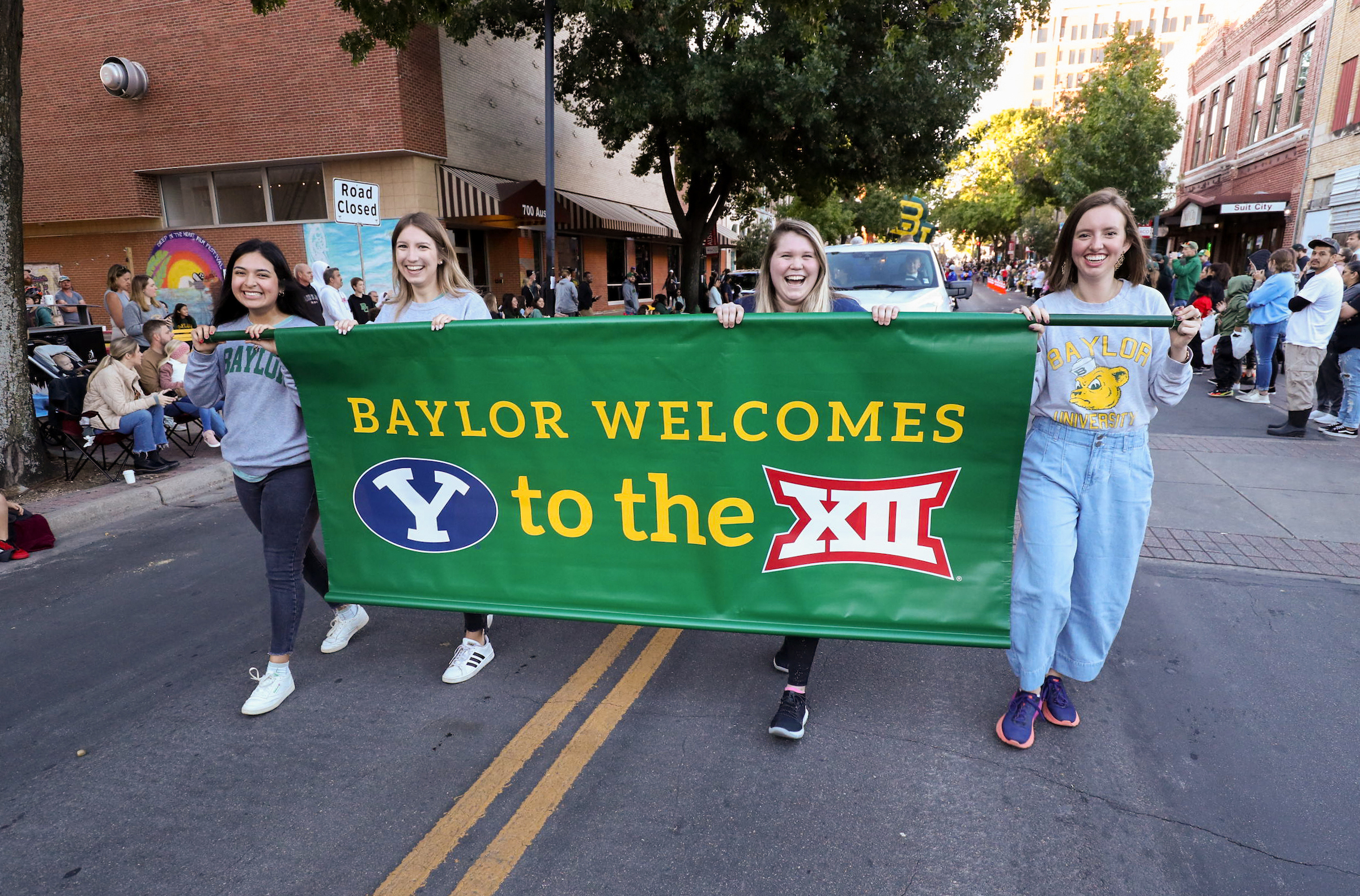 Baylor students carry a banner welcoming BYU during the homecoming parade in Waco, Texas, on Saturday, Oct. 16, 2021.